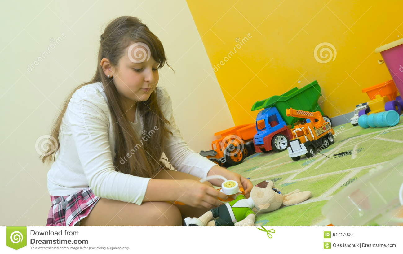 Cute Girl Playing Doctor With Rabbit On The Floor Stock Footage