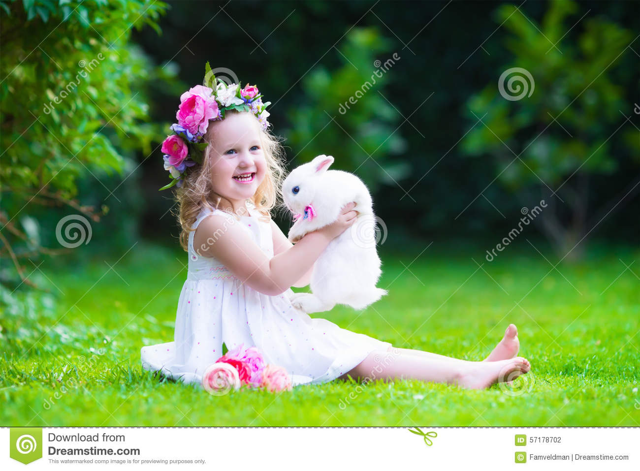cute girl playing with real bunny stock photo - image of grass