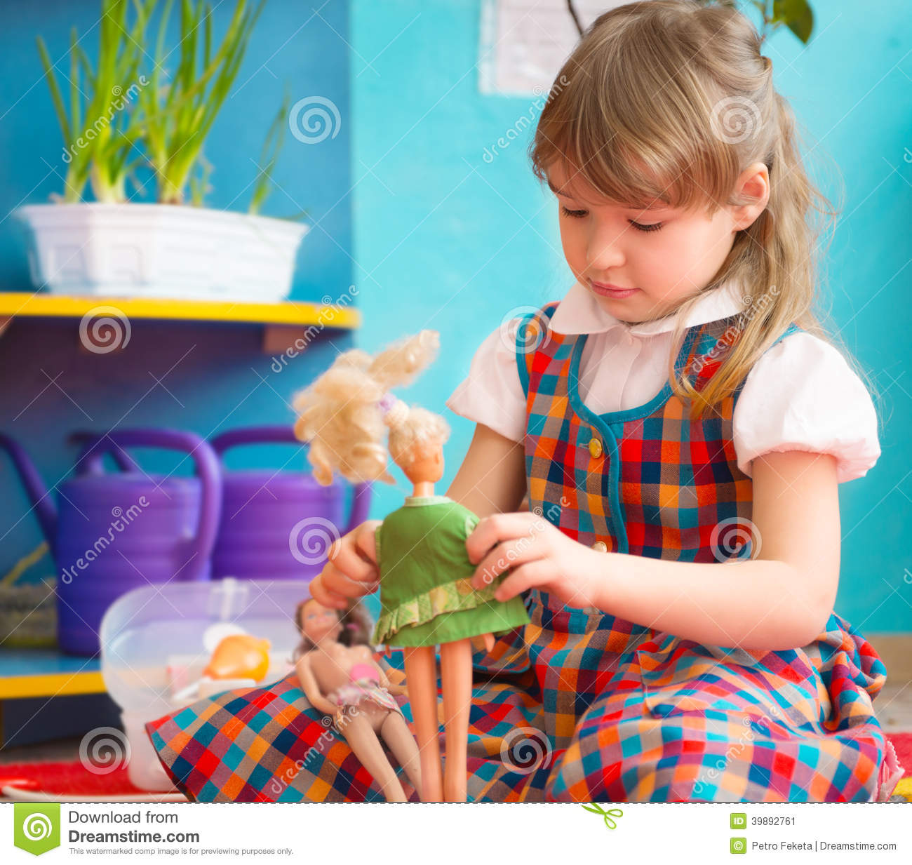 Adorable Little Girl Playing With Beach Toys During: Cute Girl Playing With Toy Doll At Kindergarten Stock