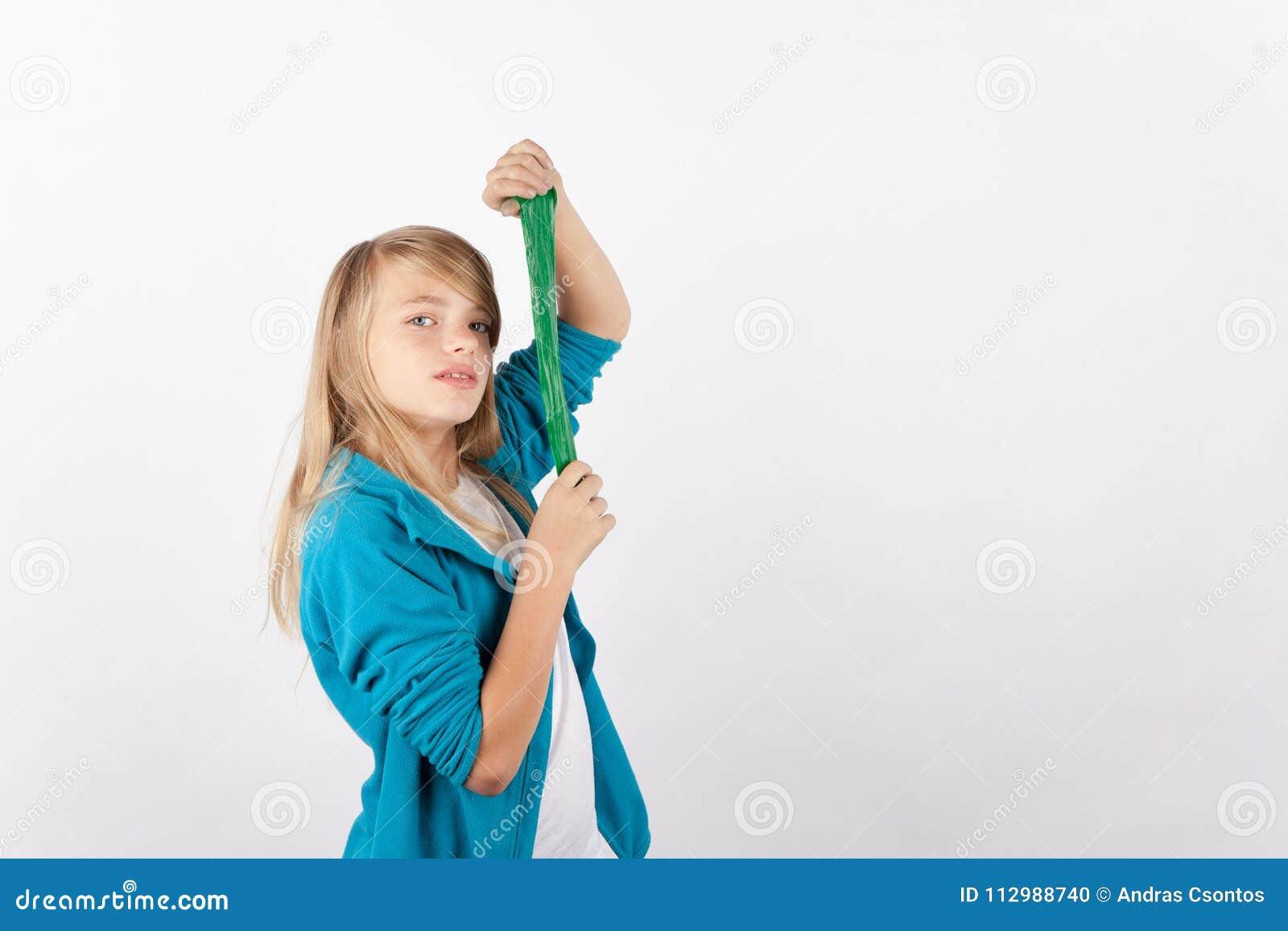 Cute girl posing with her handmade slime