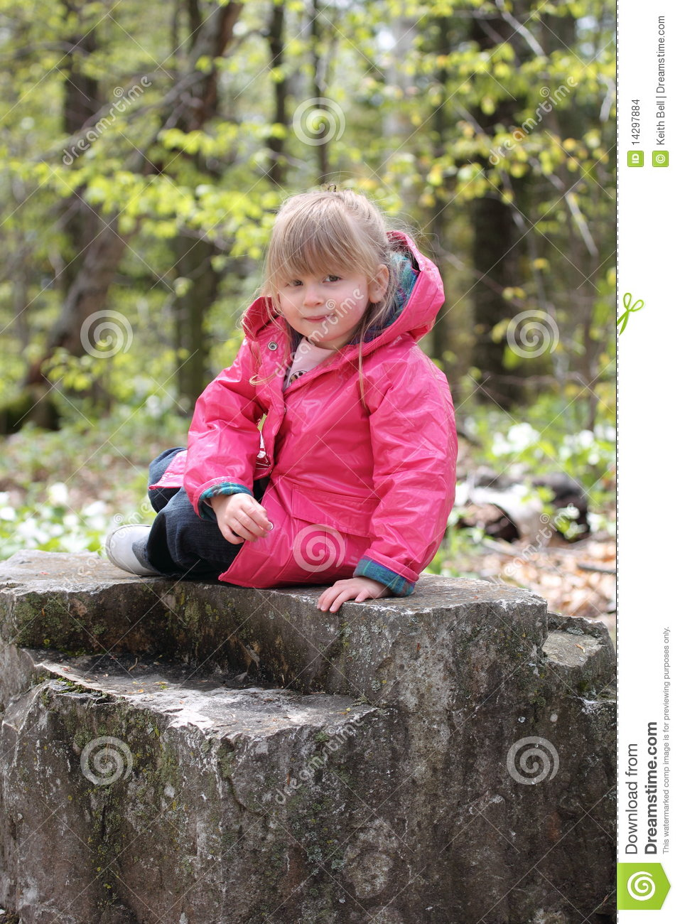 Cute Girl Posing While Reclining on a Rock
