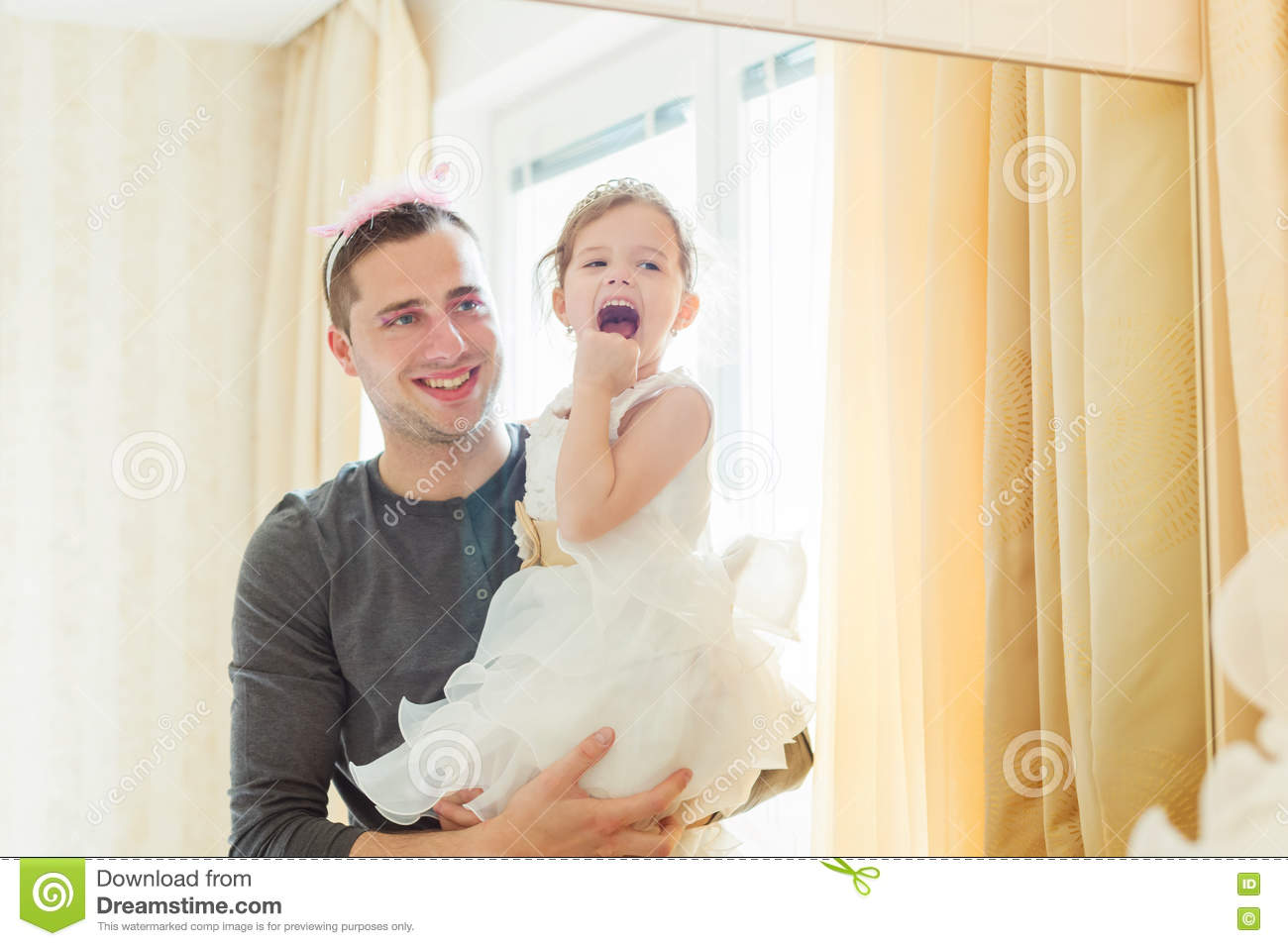 Cute girl that put on make up on her father