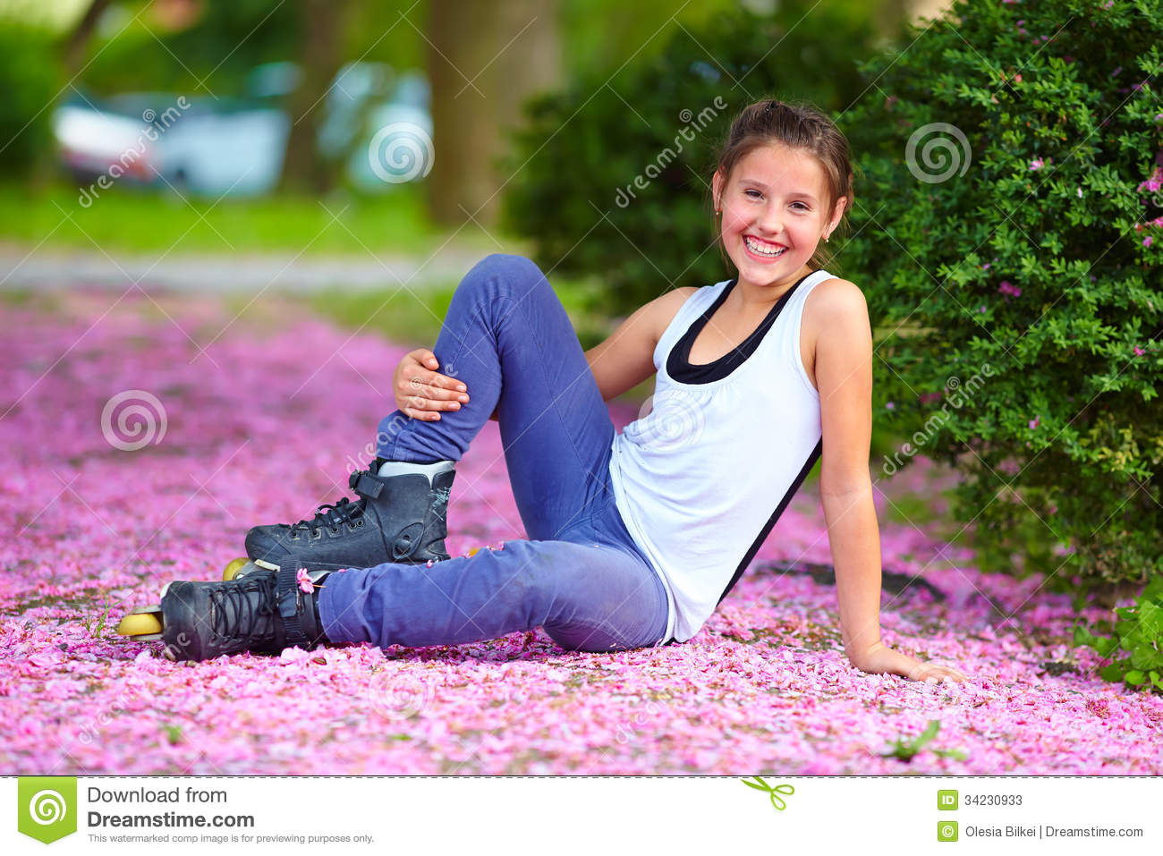 Cute Girl Roller-skater In Spring Park Stock Photos - Image: 34230933