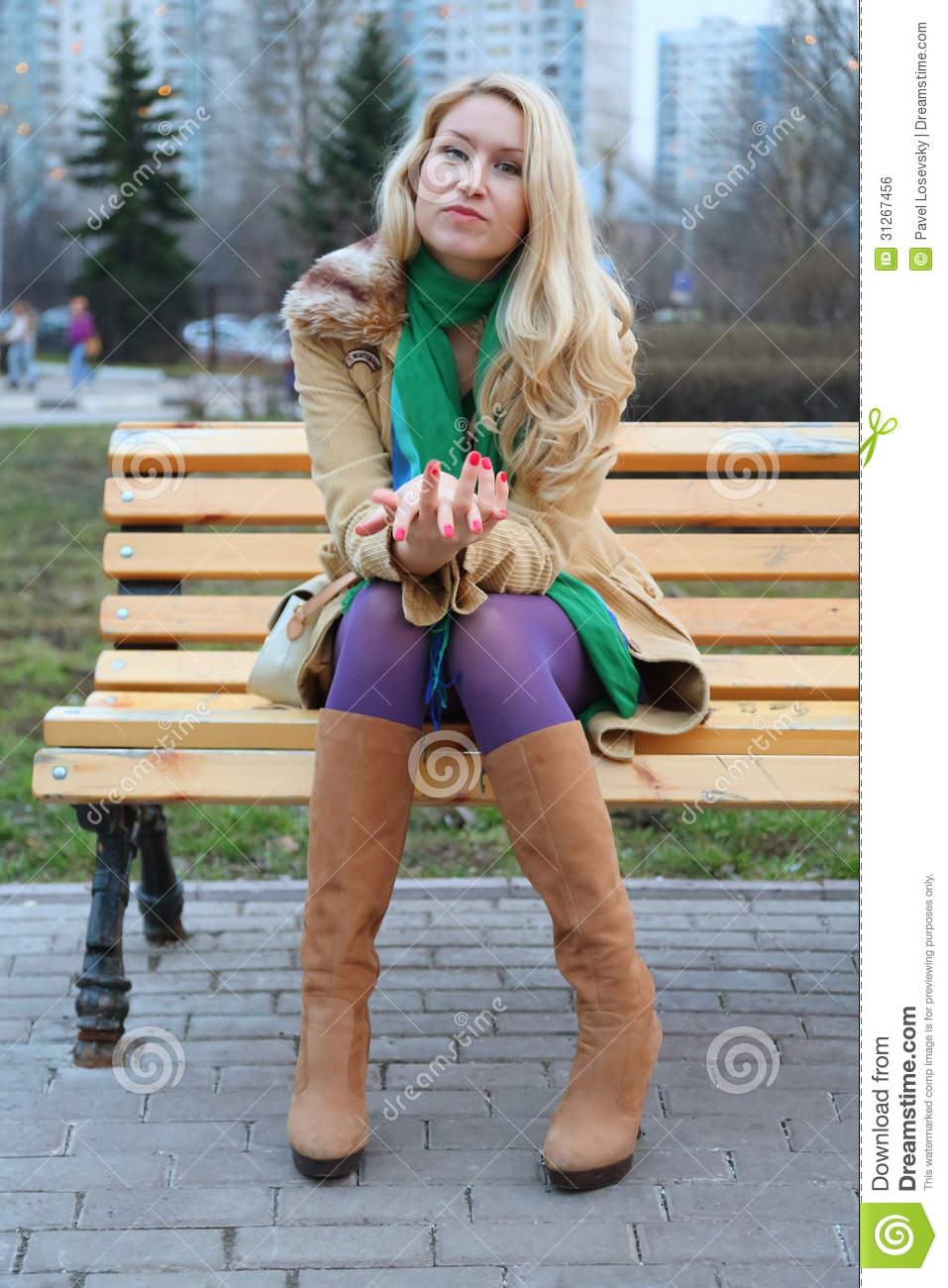 Cute girl sitting on a bench.