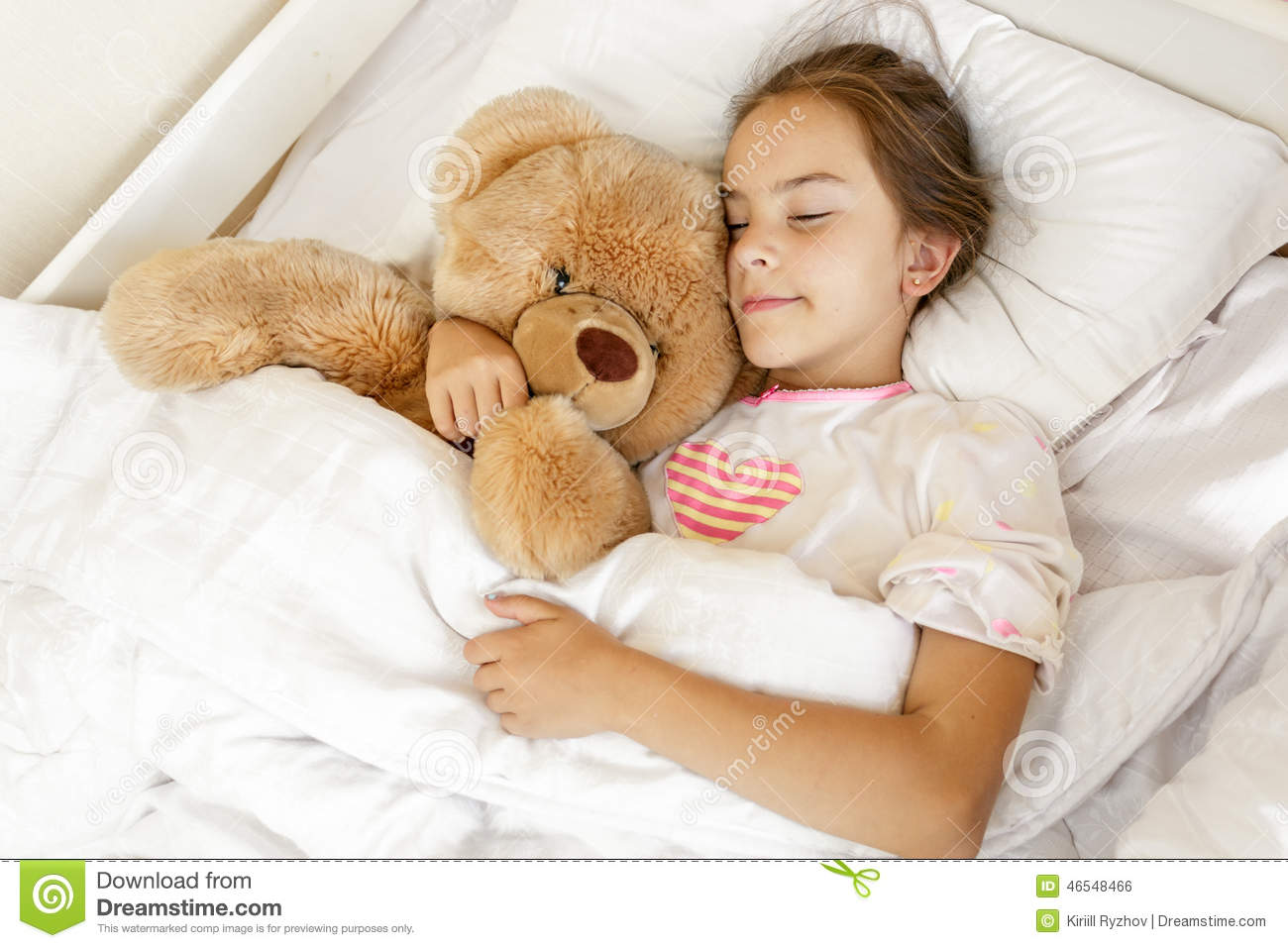 Cute Girl Sleeping And Hugging Big Teddy Bear At Bed Stock