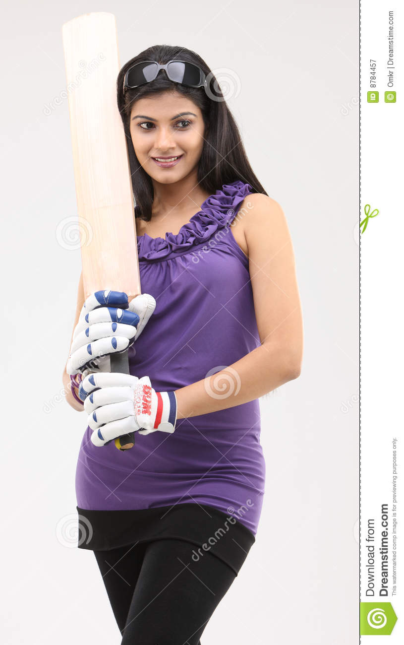 Cute girl standing with cricket bat