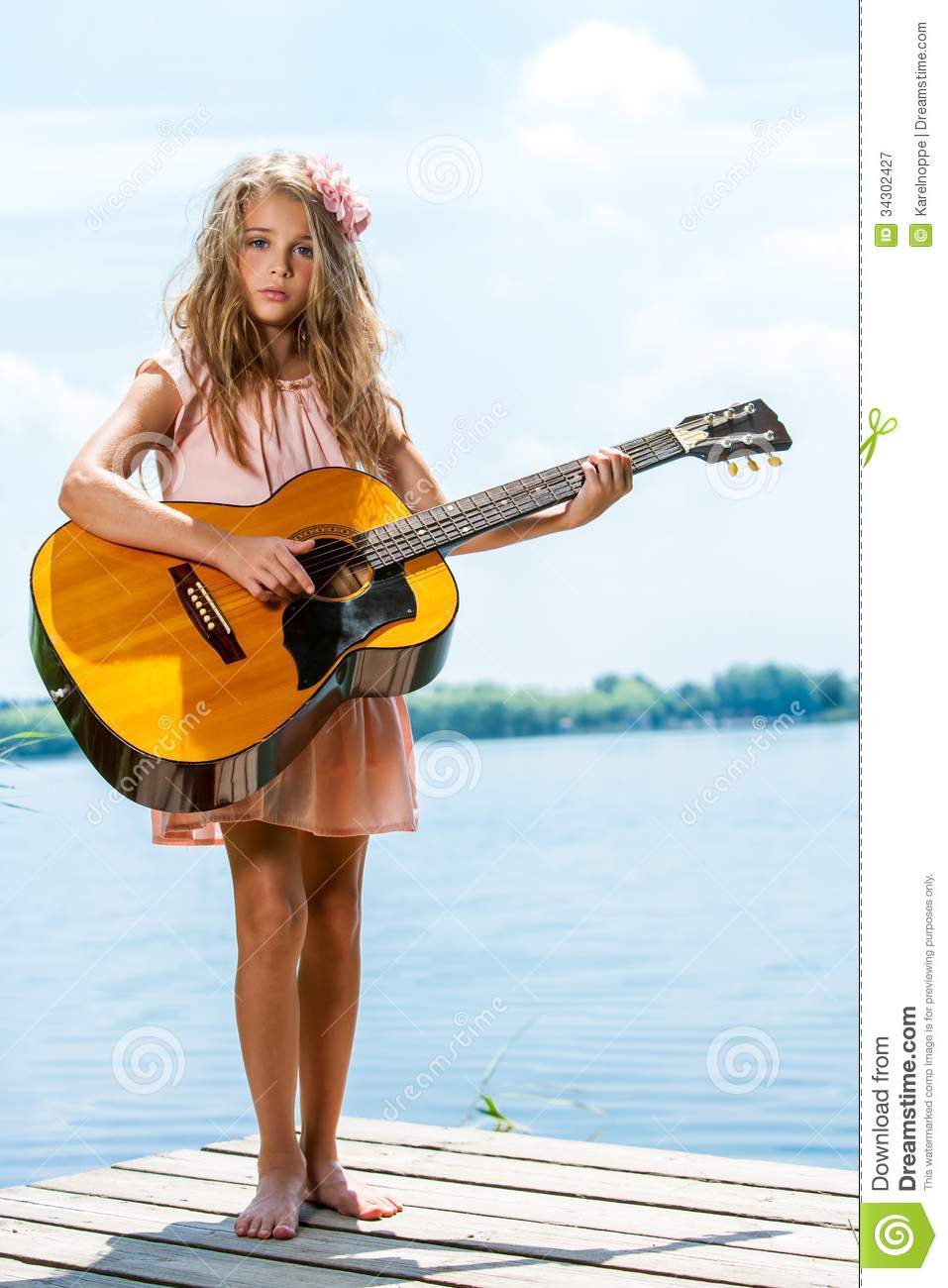 Cute Girl Standing With Guitar At Lake