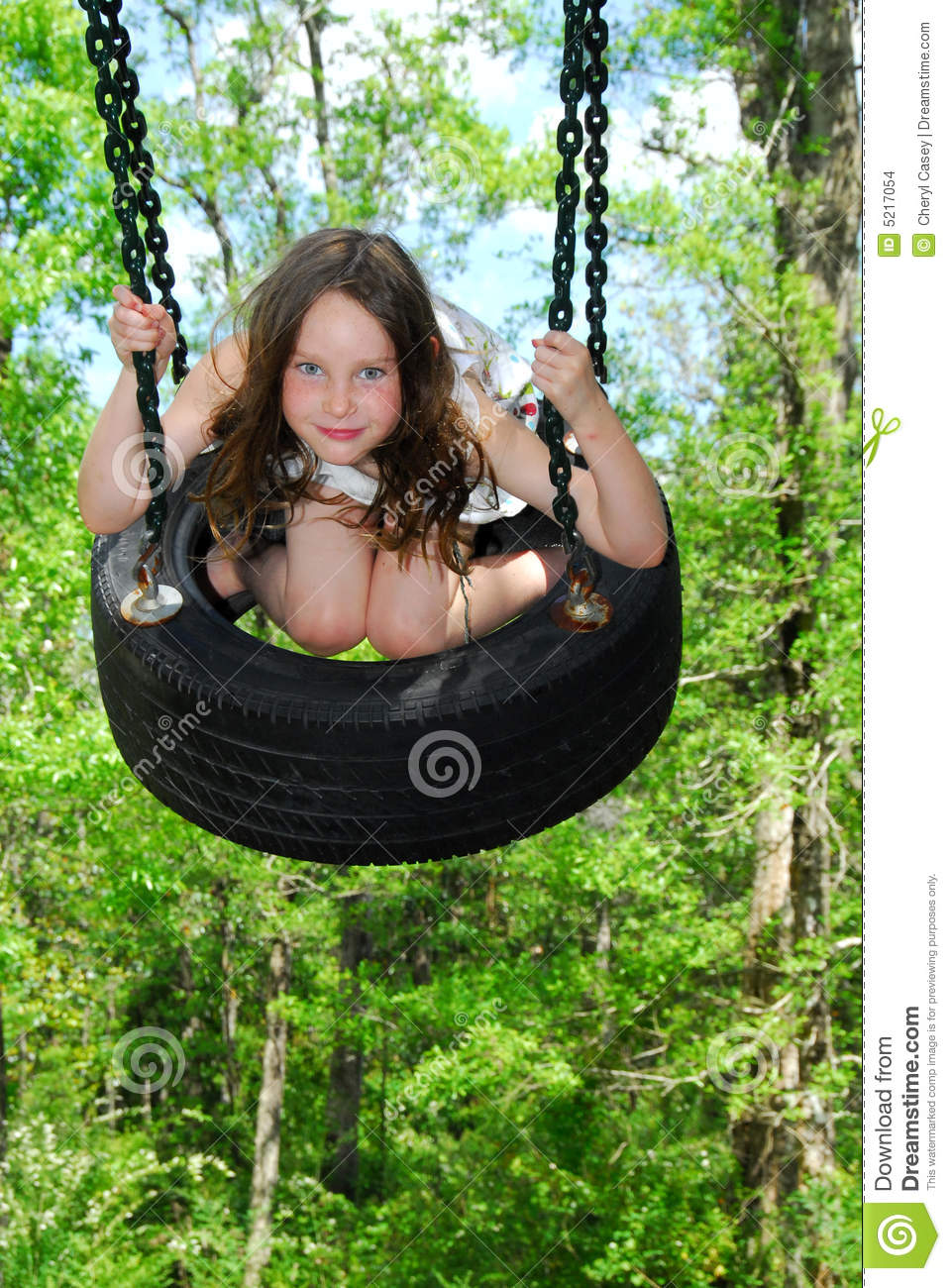Cute Girl On Tire Swing Stock Images - Image: 5217054