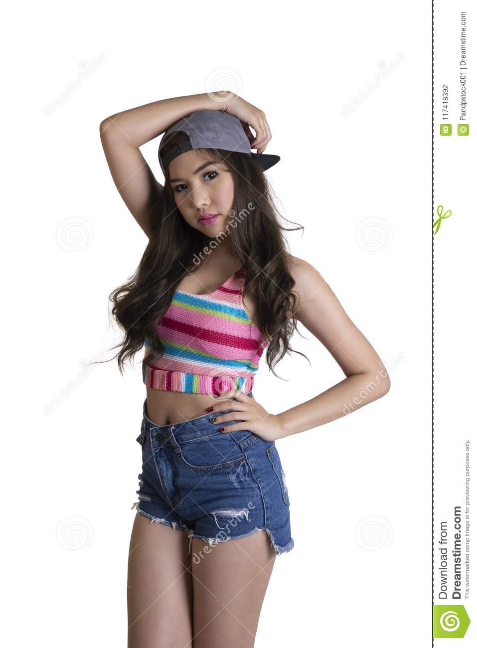 7676969e5b Cute Girl Wareing Blue Jeans Shorts And Colorful Vest With Cap F ...