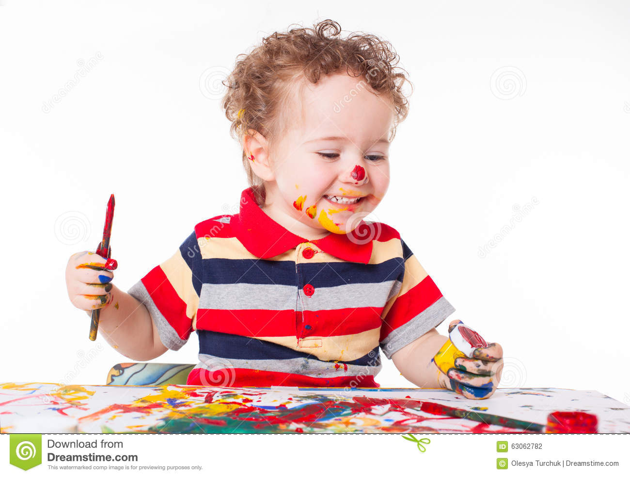Cute Happy Baby Boy Playing With Paints Stock Photo