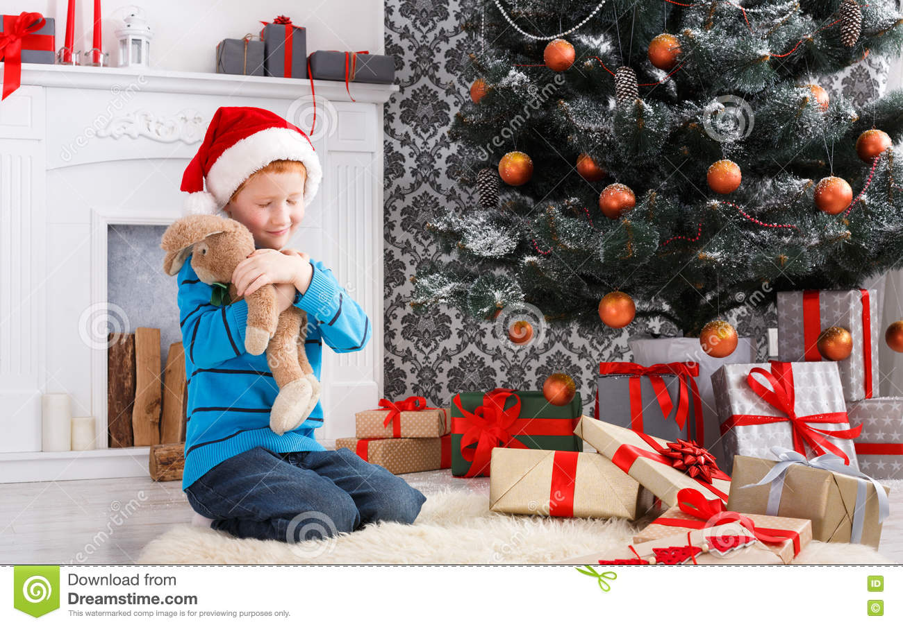Download Cute Happy Boy In Santa Hat With Toy Christmas Presents Stock Image