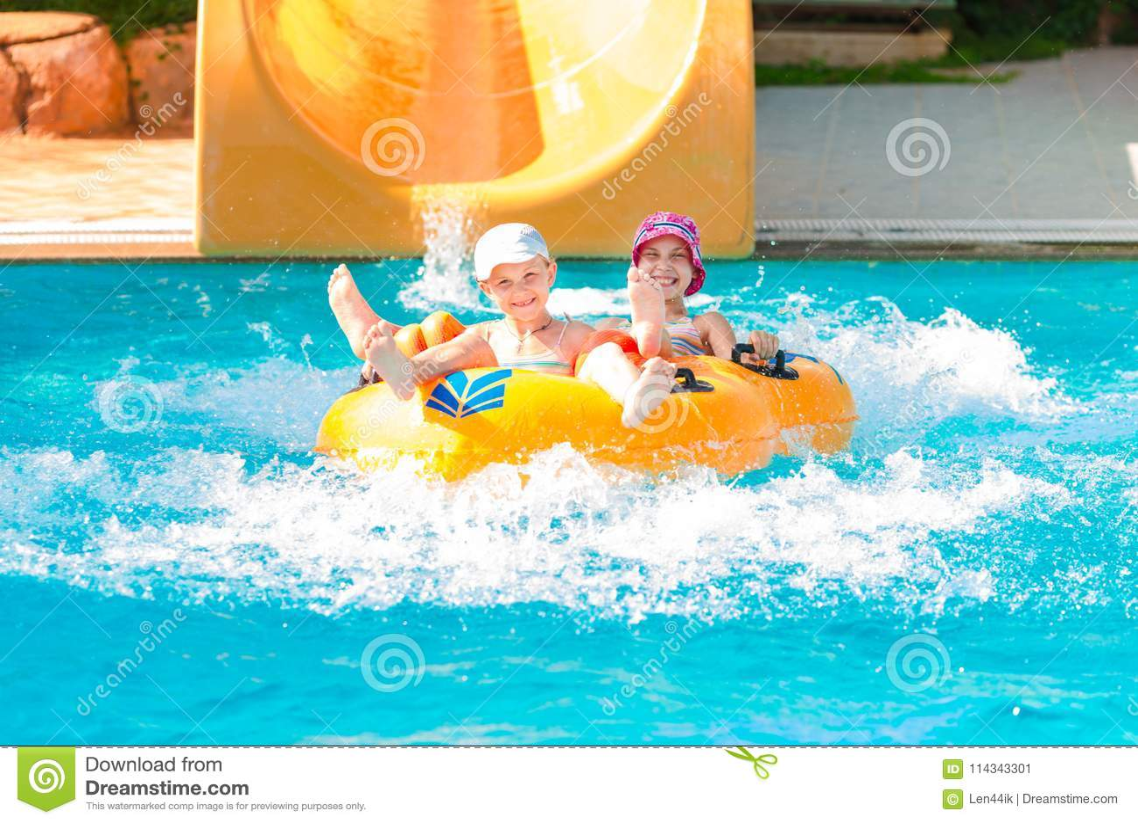 Cute happy girls in amusment aquapark