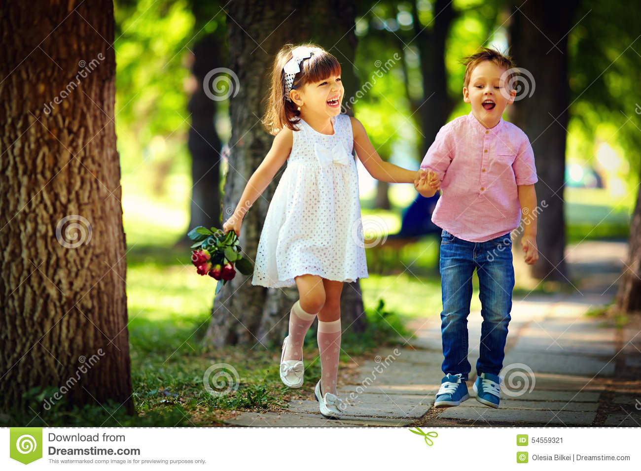 cute happy kids jumping in summer park stock image - image of love