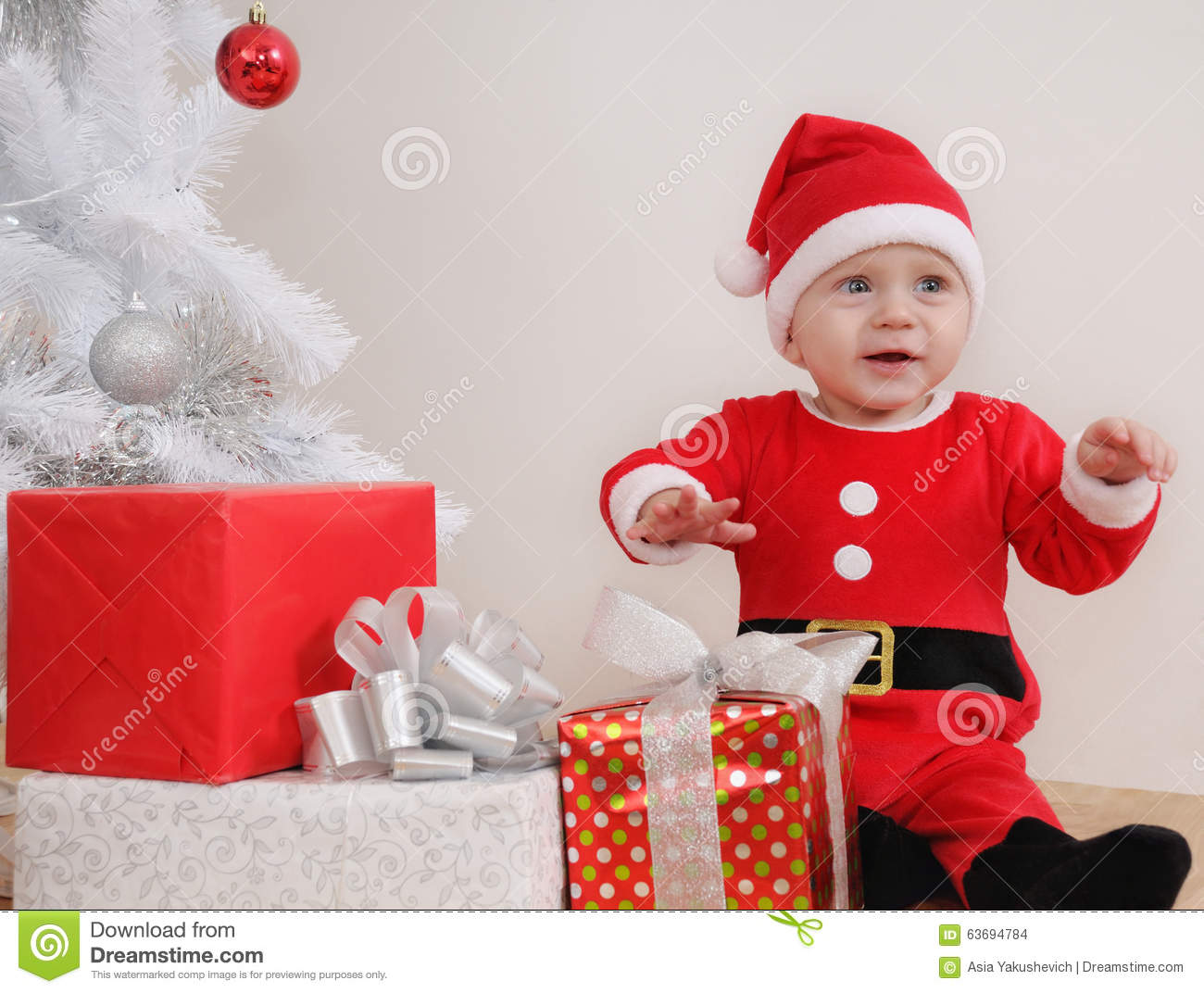 Cute Baby Gifts For Christmas : Cute happy little baby boy in santa suit with gifts near
