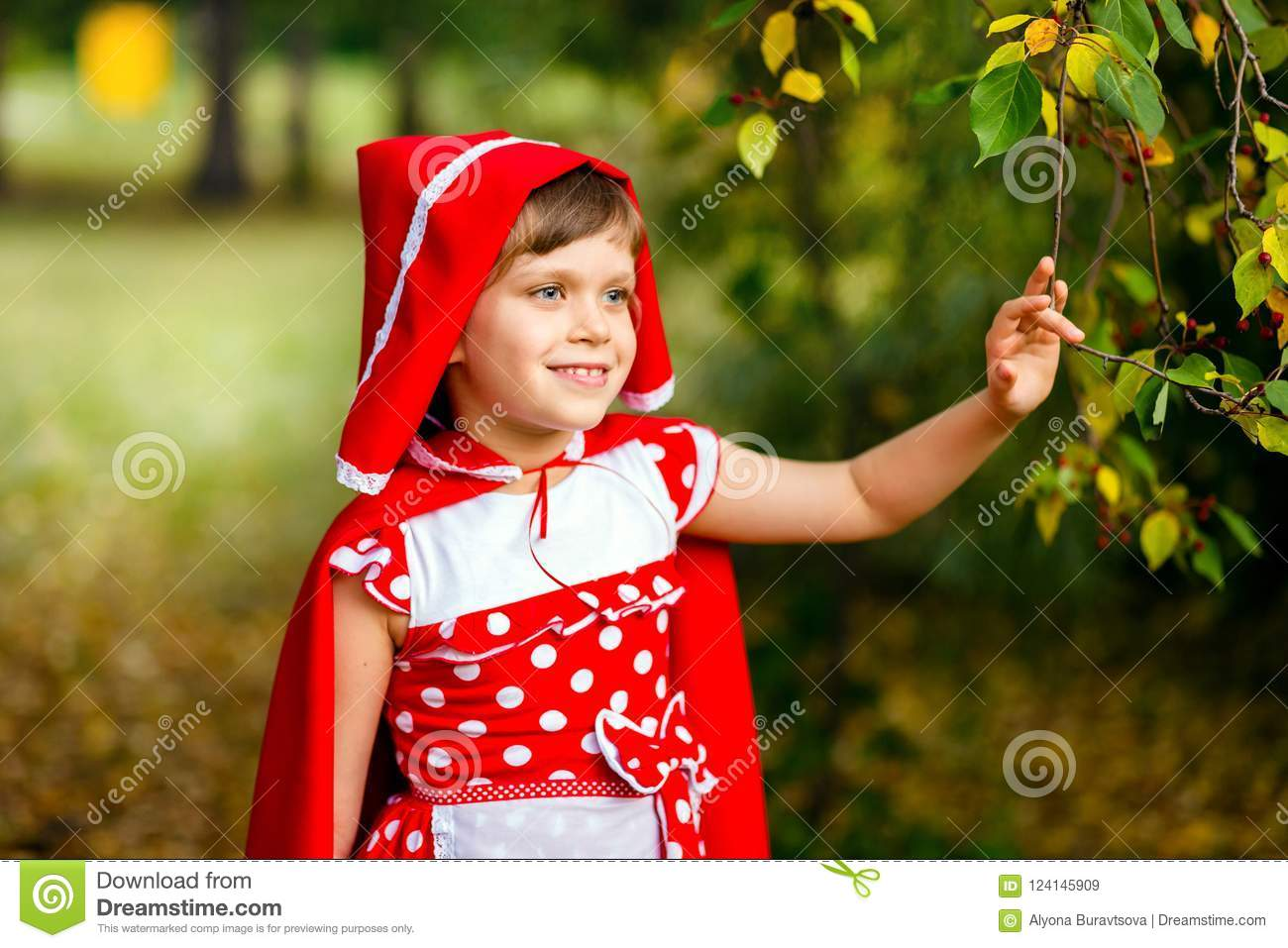 Cute seven years old girl in autumn outdoors