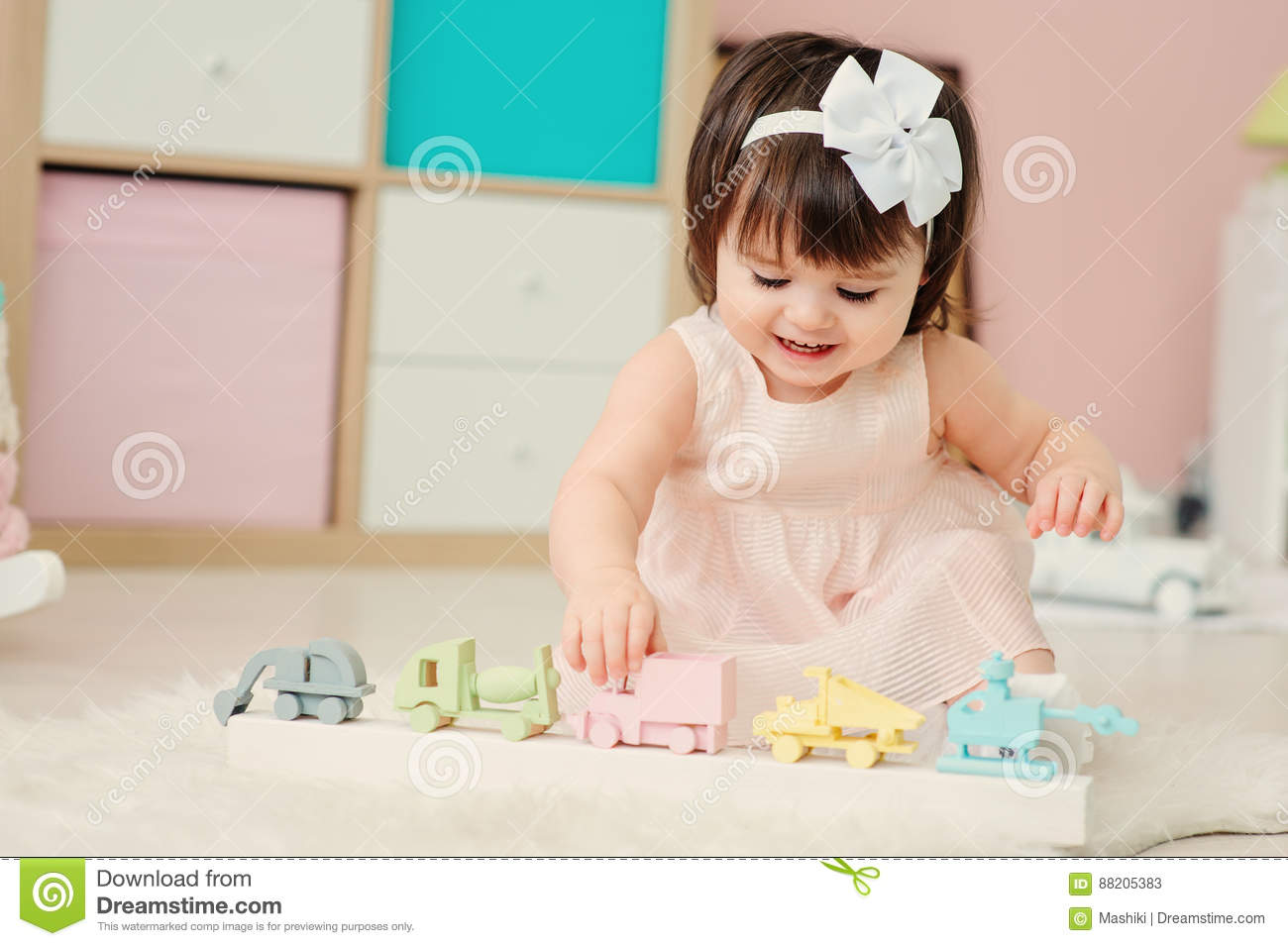 Cute Happy 1 Year Old Baby Girl Playing With Wooden Toys At Home