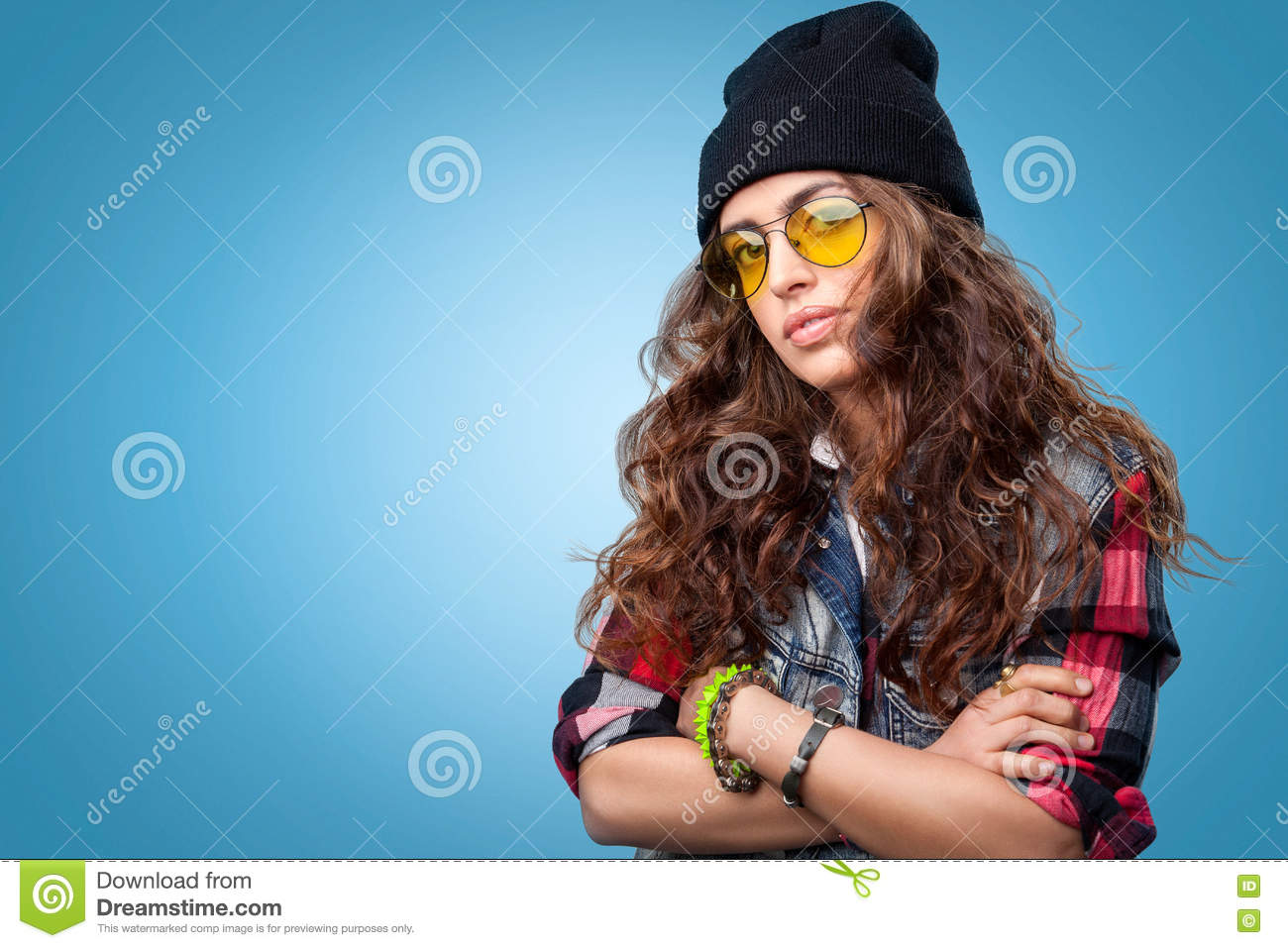 Cute Hipster Girl With Curly Hair Wearing Black Beanie Hat Posing At The Camera With Crossed Arms Stock Image Image Of Jeans Fashion 70882755