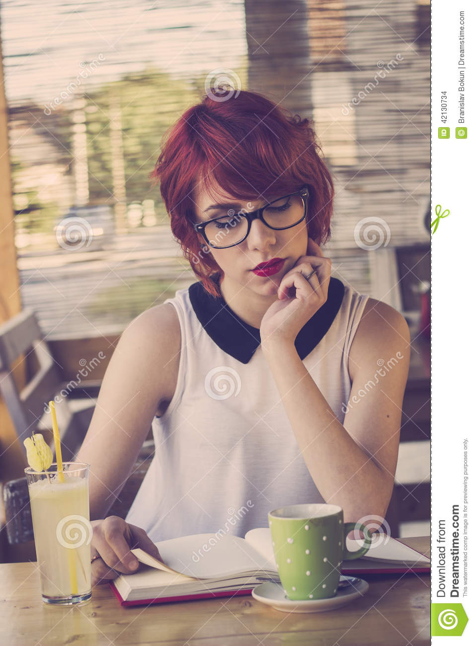 Cute Hipster Teenage Girl Reading A Book Stock Photo