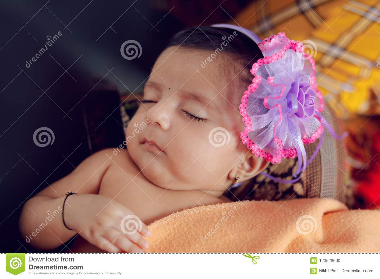 cute indian baby girl sleeping on bed stock photo - image of