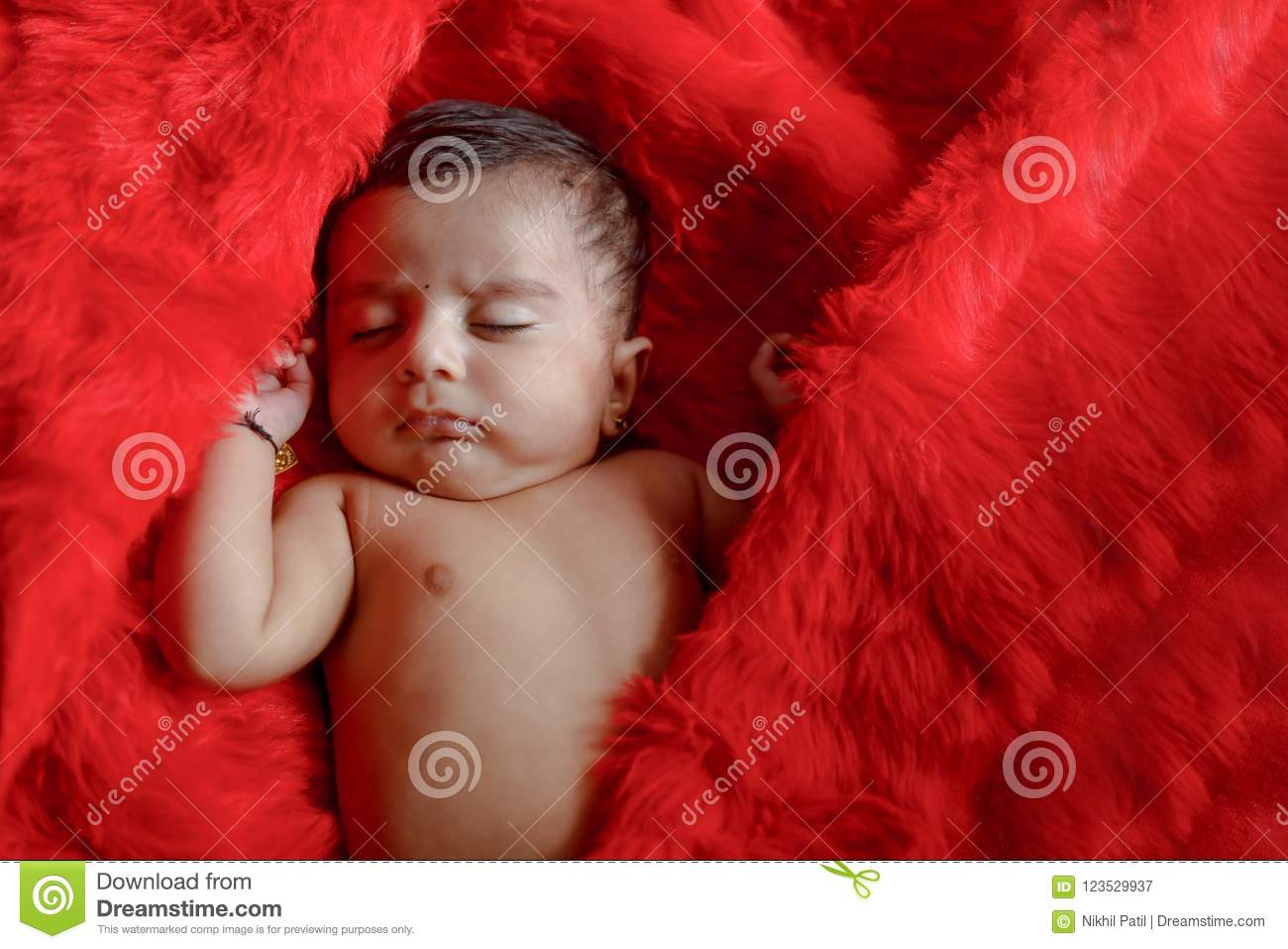cute indian baby girl sleeping on bed stock image - image of face