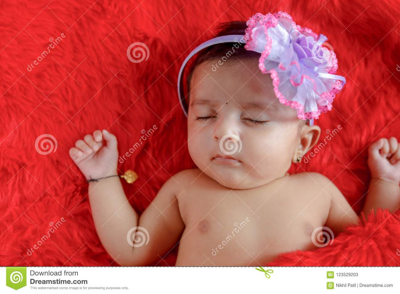 cute indian baby girl sleeping on bed stock image - image of hair