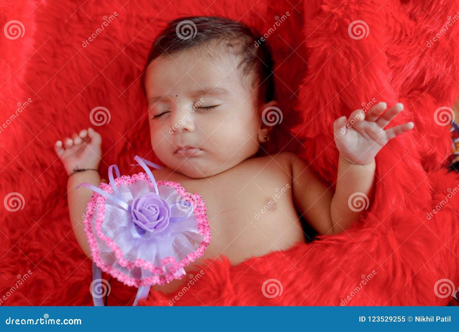 cute indian baby girl sleeping on bed stock image - image of girl