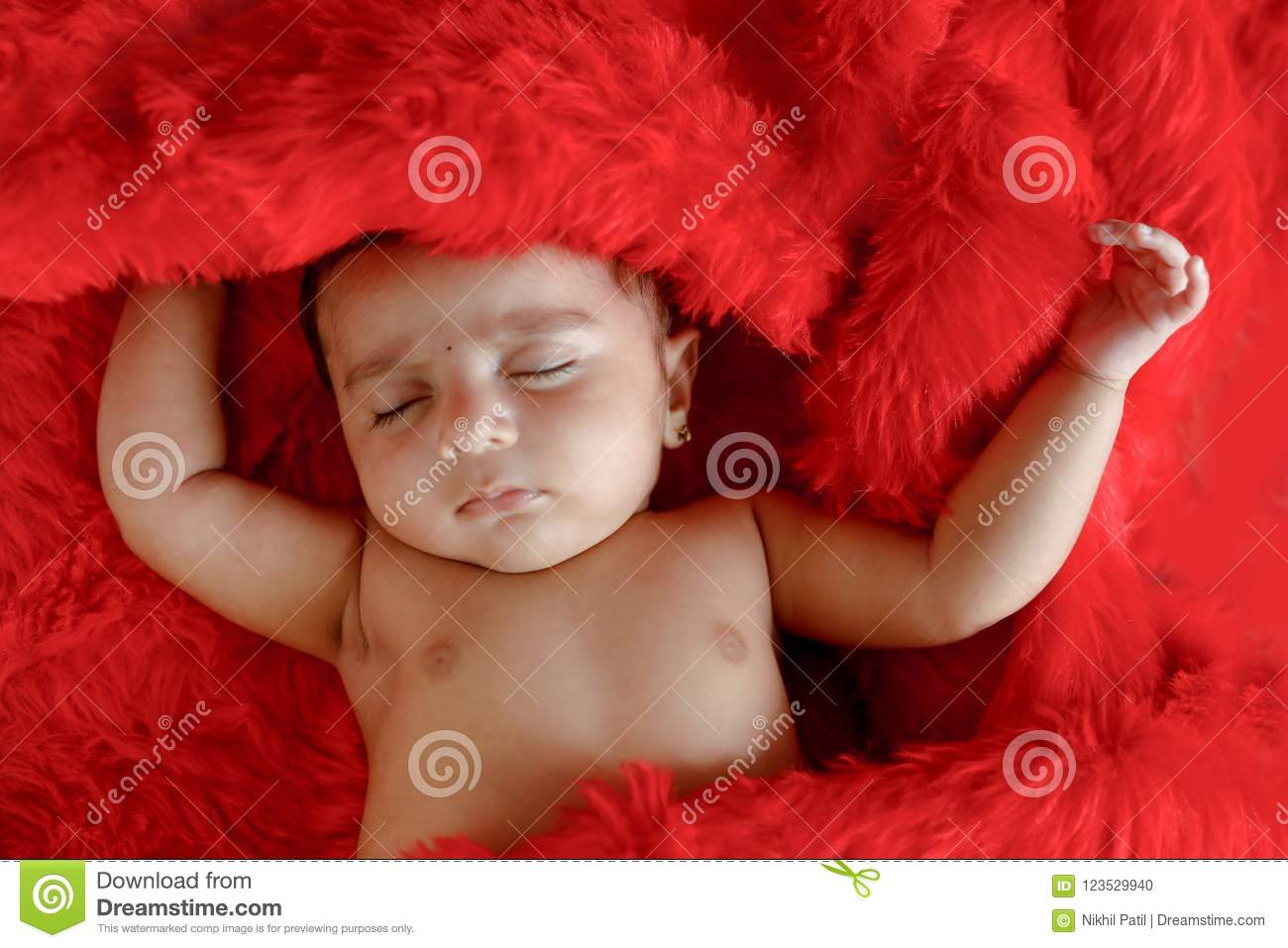 cute indian baby girl sleeping on bed stock photo - image of face
