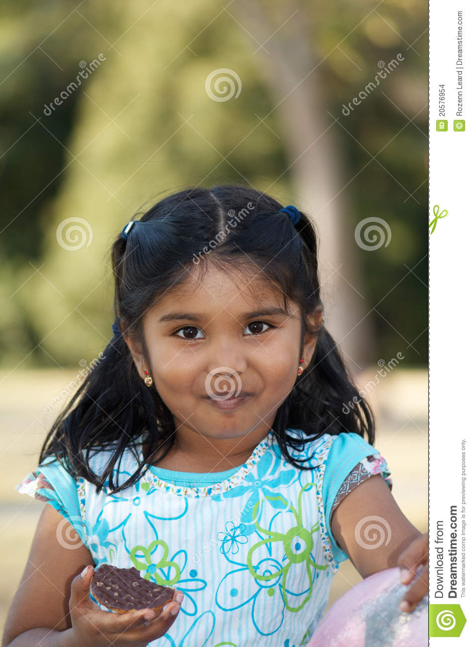 Cute Indian Child Eating Biscuit Stock Photo Image Of Girl Sweet
