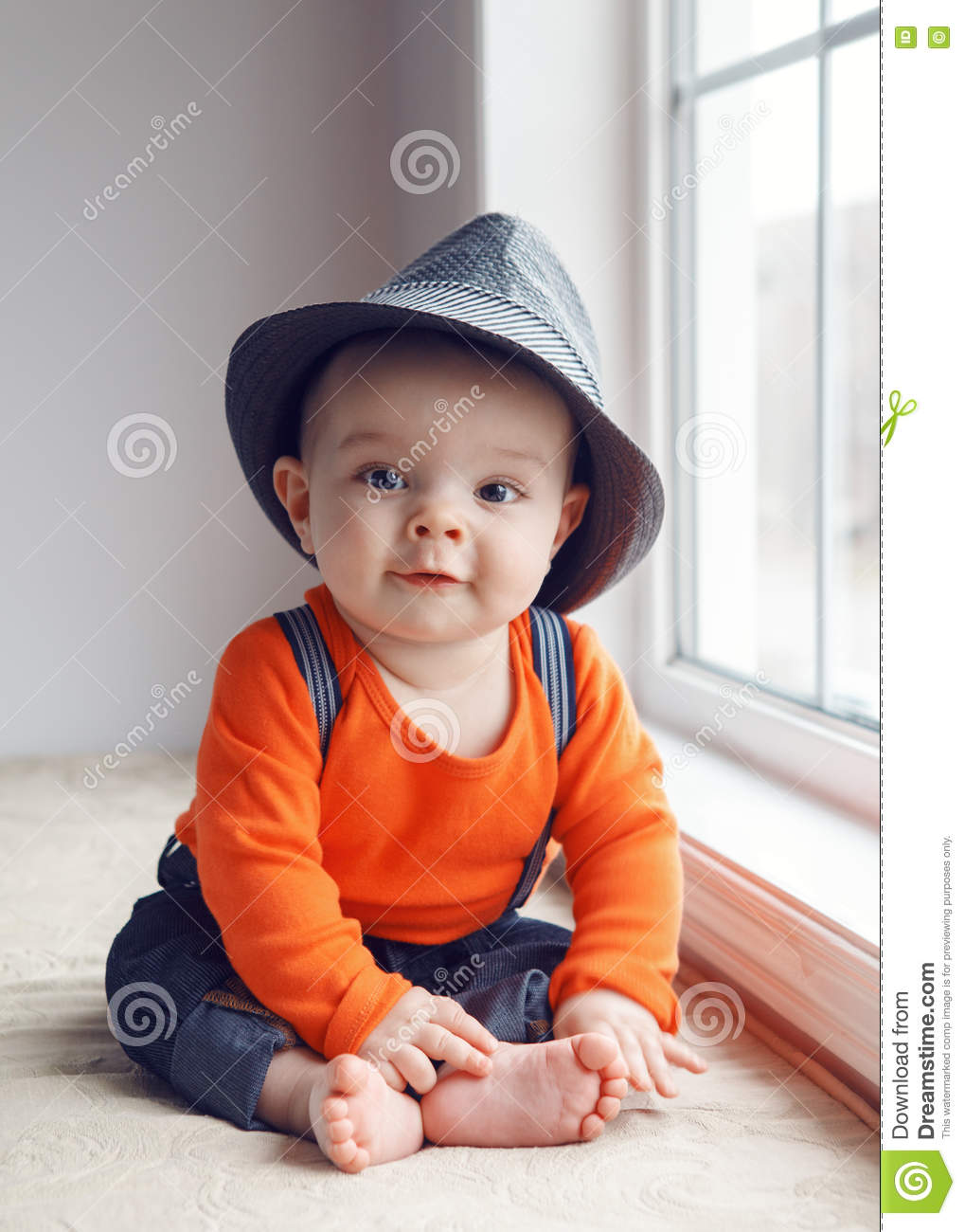 cb2c006610861 Portrait of cute adorable stylish Caucasian baby boy with black eyes in  hat