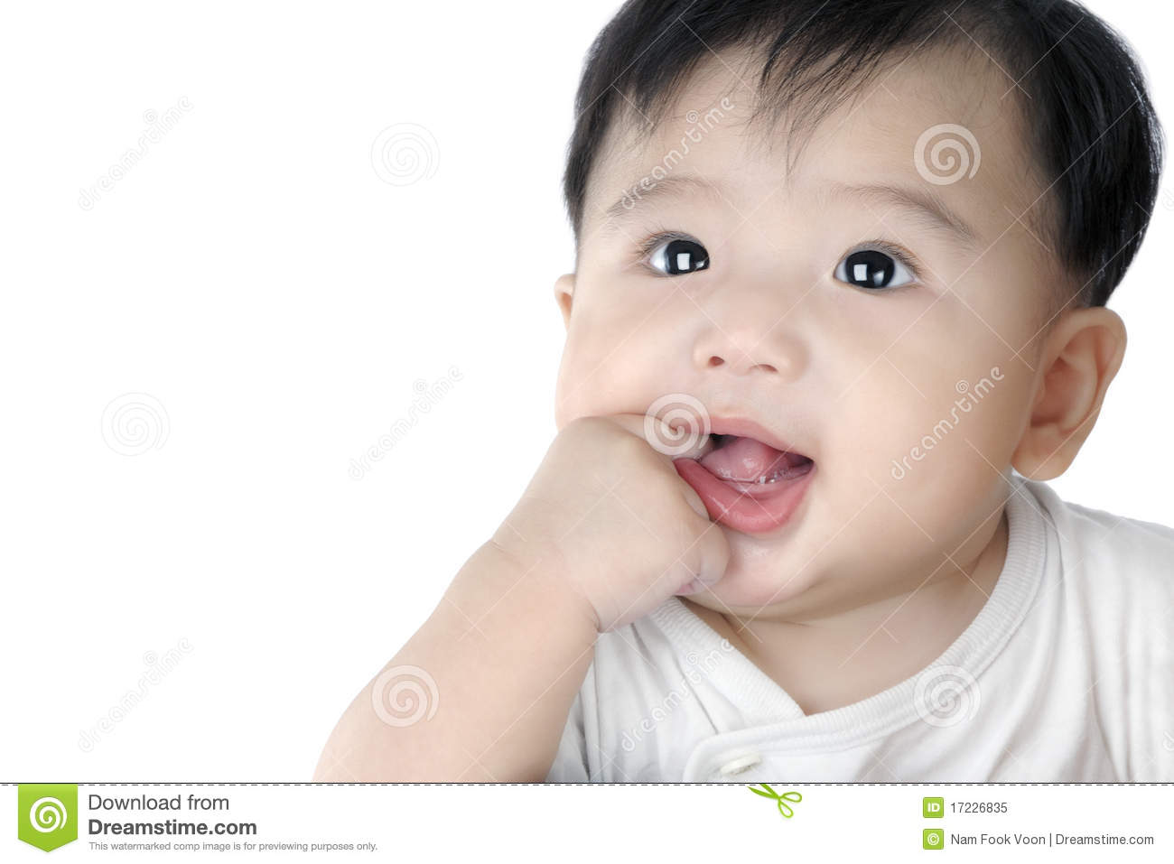 Adorable infant baby putting finger into his mouth isolated on white