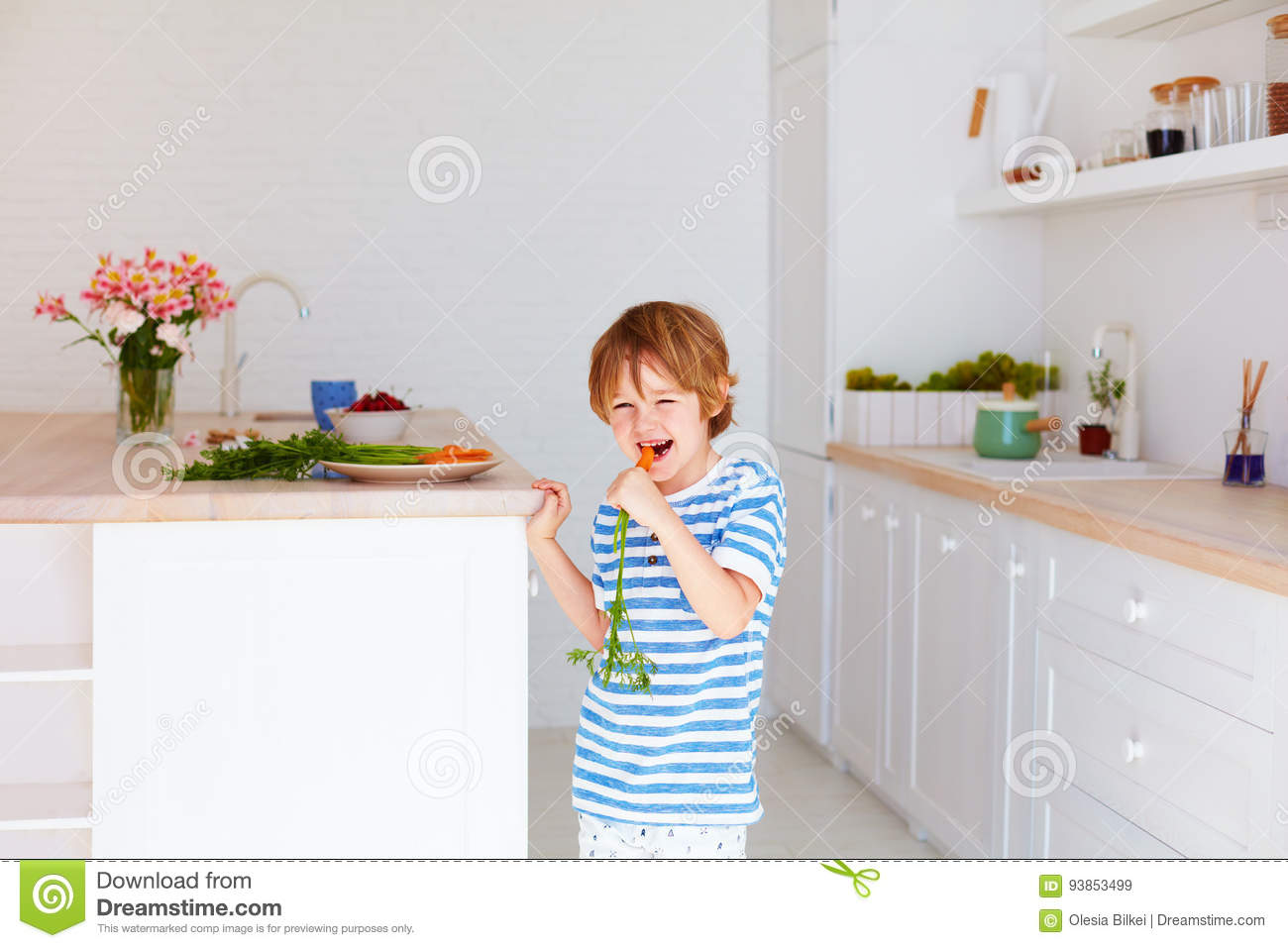Cute Kid, Boy Eating Tasty Fresh Carrot In The Kitchen Stock Image ...