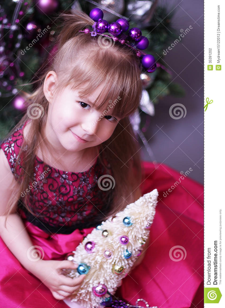 cute kid with christmas tree stock photo - image of happiness