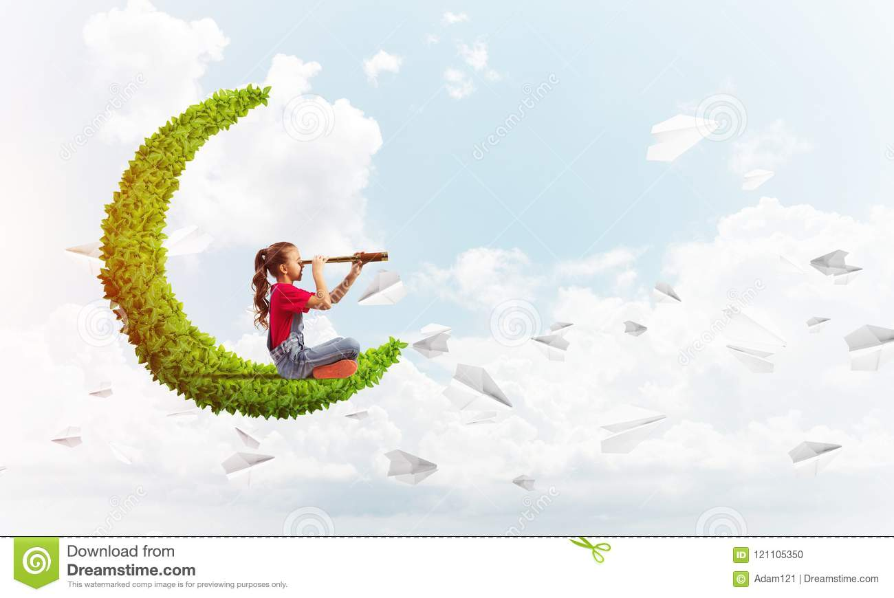 Concept of careless happy childhood with girl on green moon