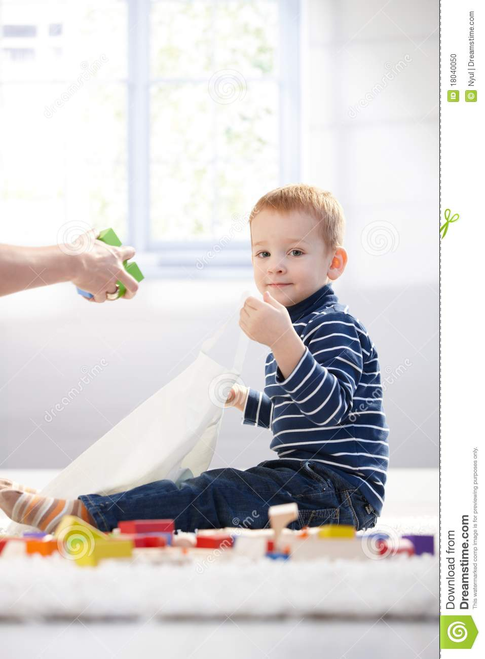 cute kid packing toys to plastic bag stock photo - image of haired