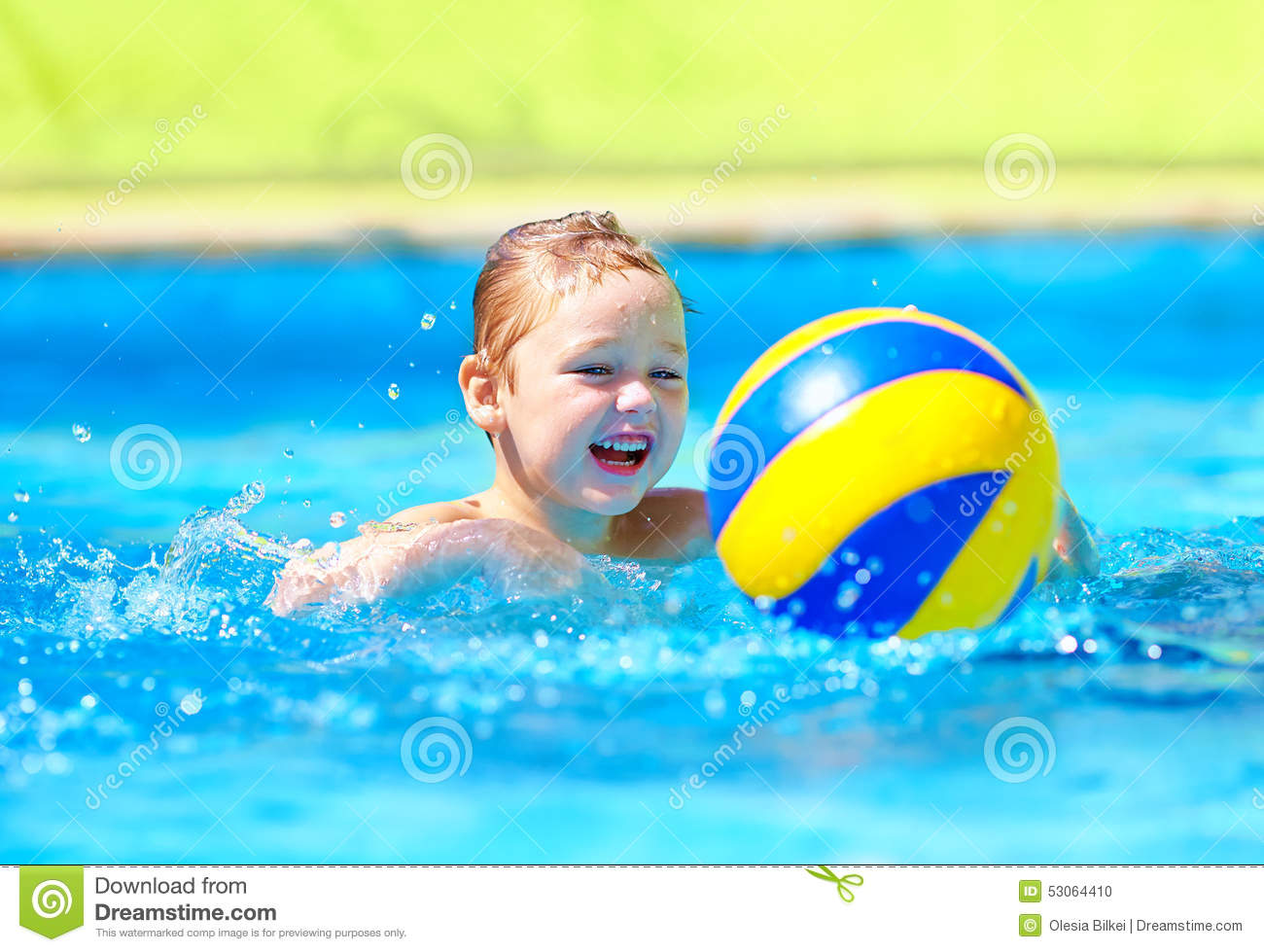Cute kid playing in water sport games in pool stock photo for Cute pool pictures