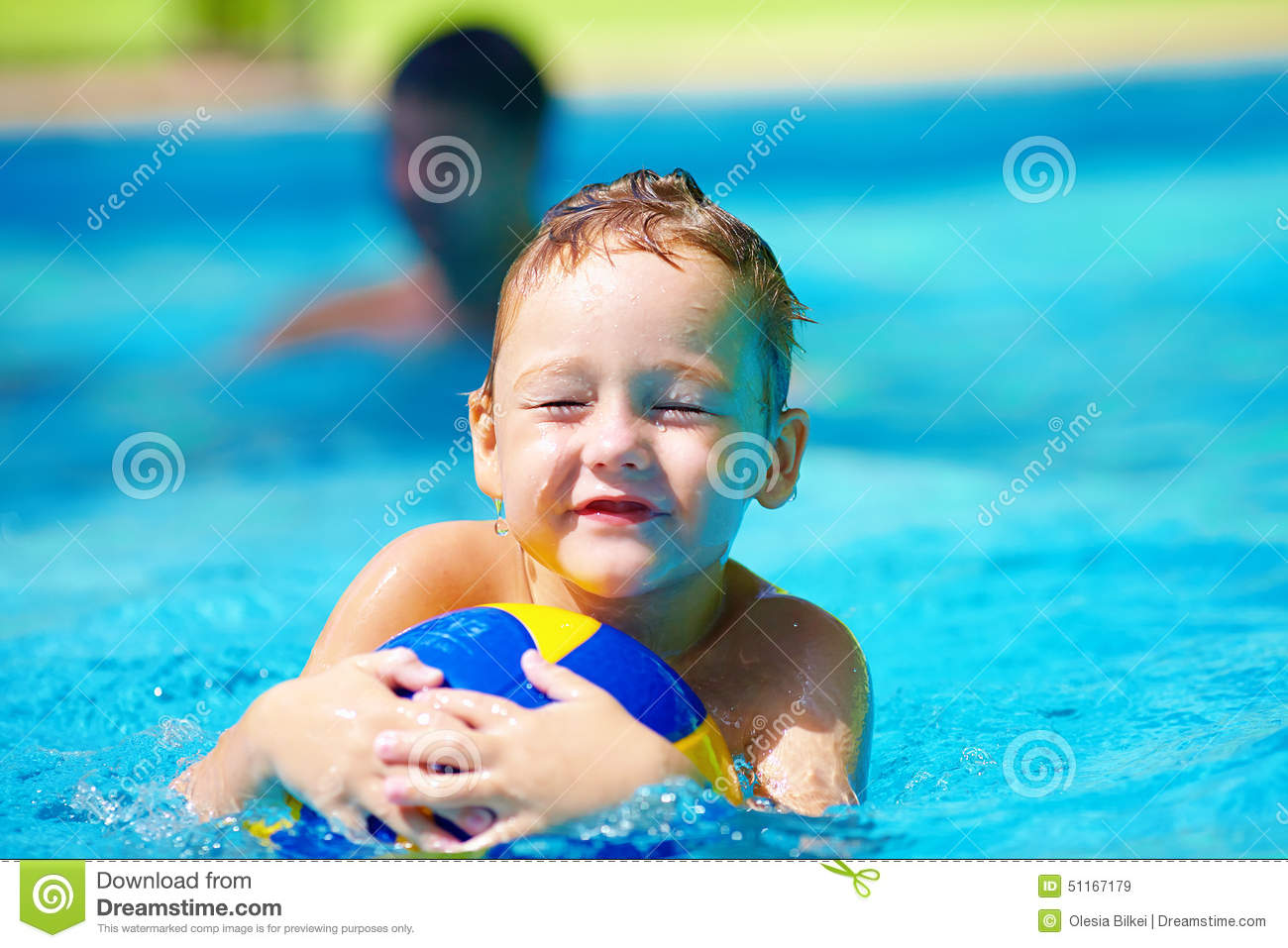 Cute kid playing water sport games in pool stock photo for Cute pool pictures
