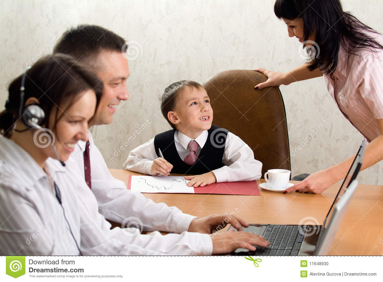 Cute kid in the role of an office manager stock photo - What is the role of an office manager ...