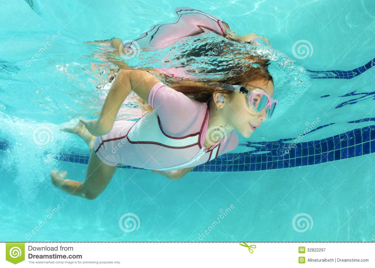 Kids Swimming Underwater cute kid swimming in pool royalty free stock photography - image