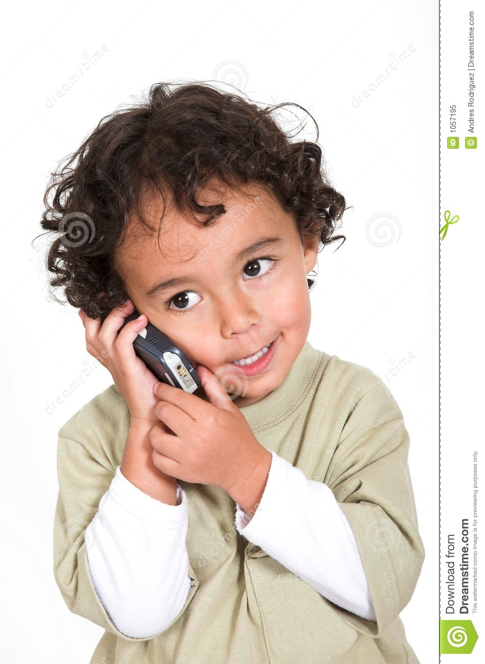 Cute Kid Talking On A Cell Phone Stock Image - Image: 1057195