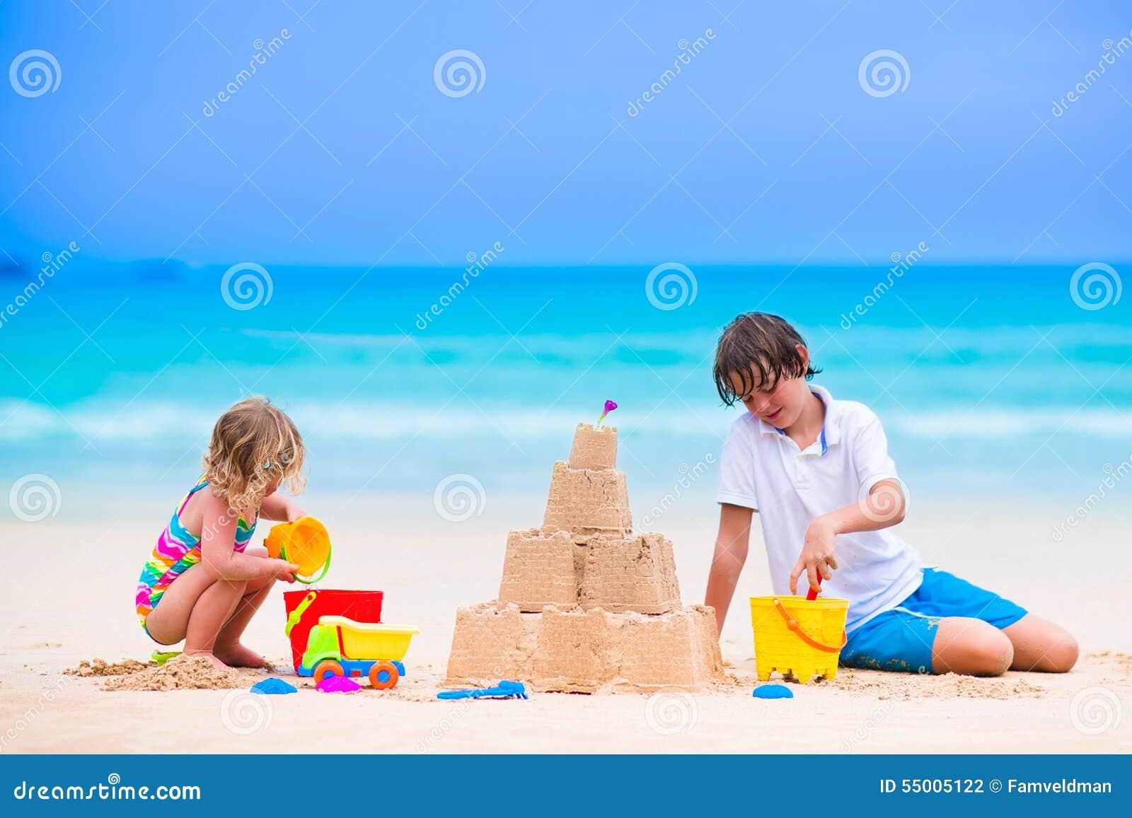 cute kids building sand castle on the beach stock photo clip art vocational clip art vocational