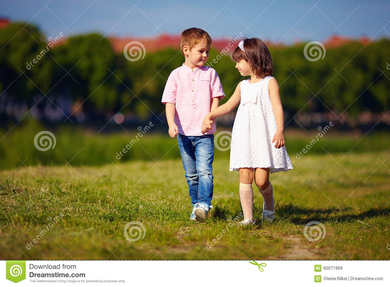 cute kids, couple walking on summer field stock image - image of