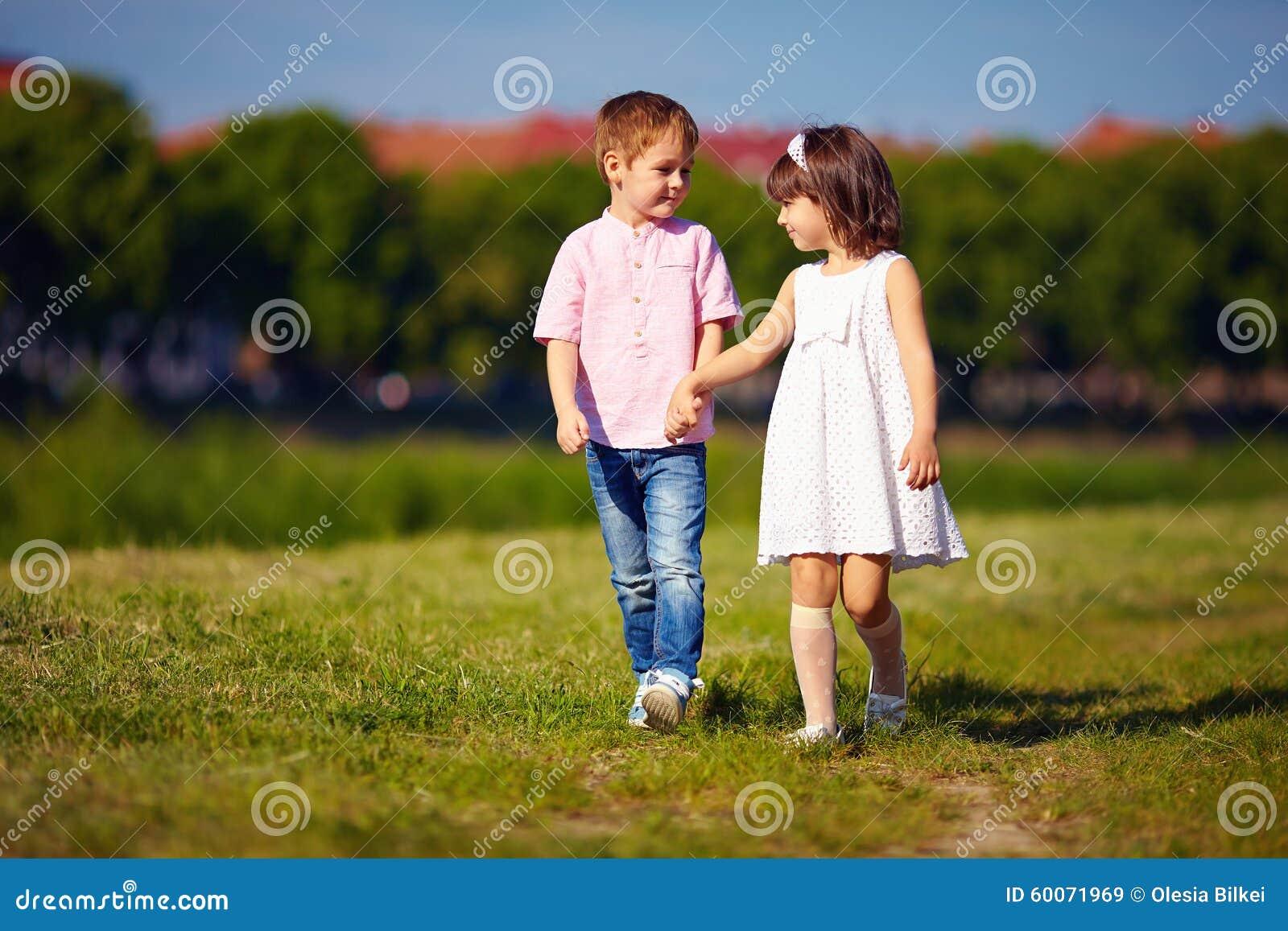 Cute Kids, Couple Walking On Summer Field Stock Photo ...