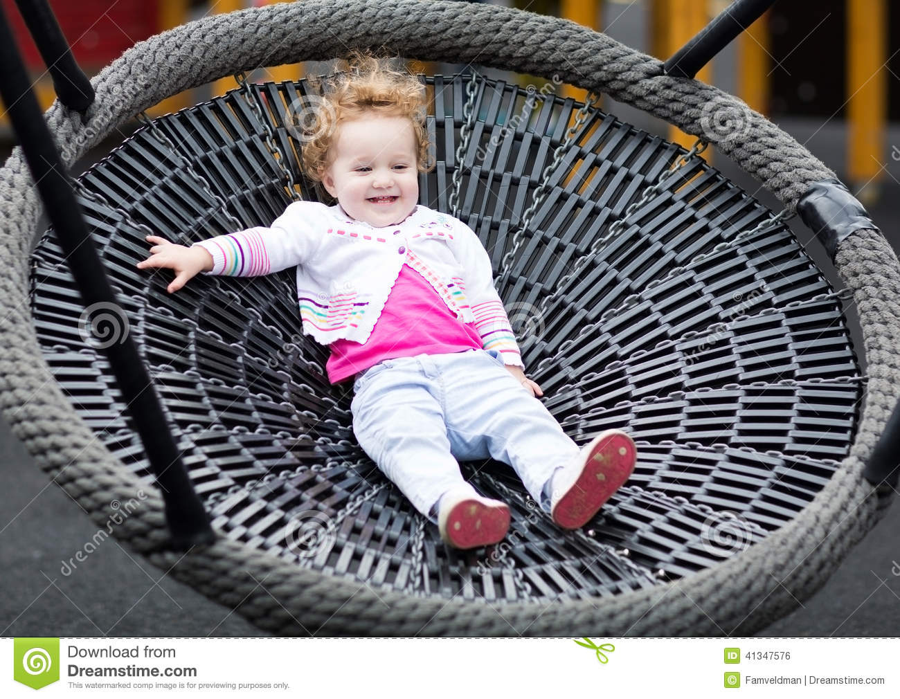 Cute Laughing Baby Girl On A Net Swing Enjoying A Sunny Day Stock Photo - Image of family