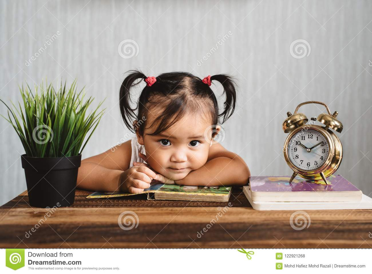 Cute Little Asian Baby Toddler Girl Looking At Camera While