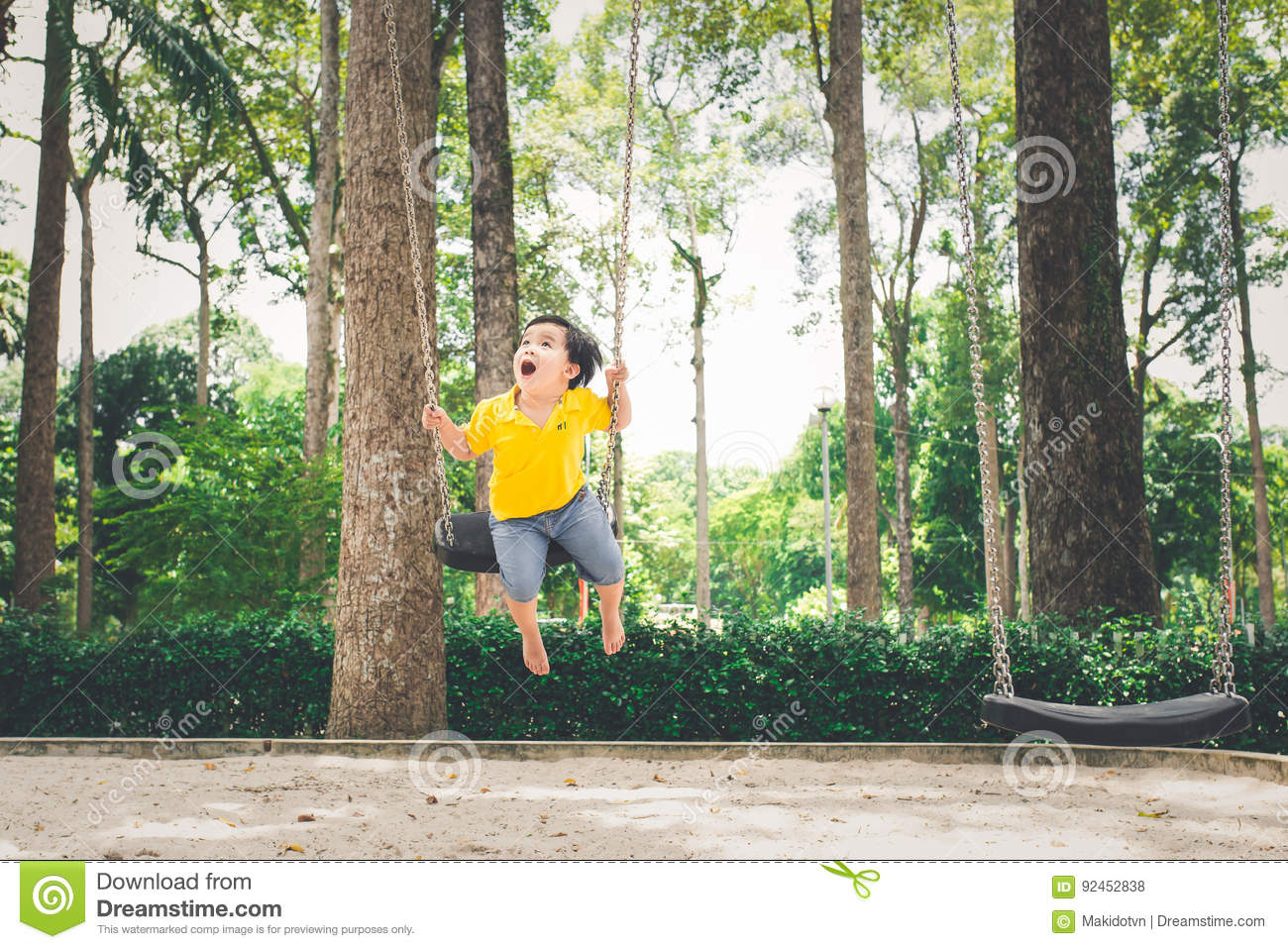 Cute little asian boy in a park on a nice day outdoors