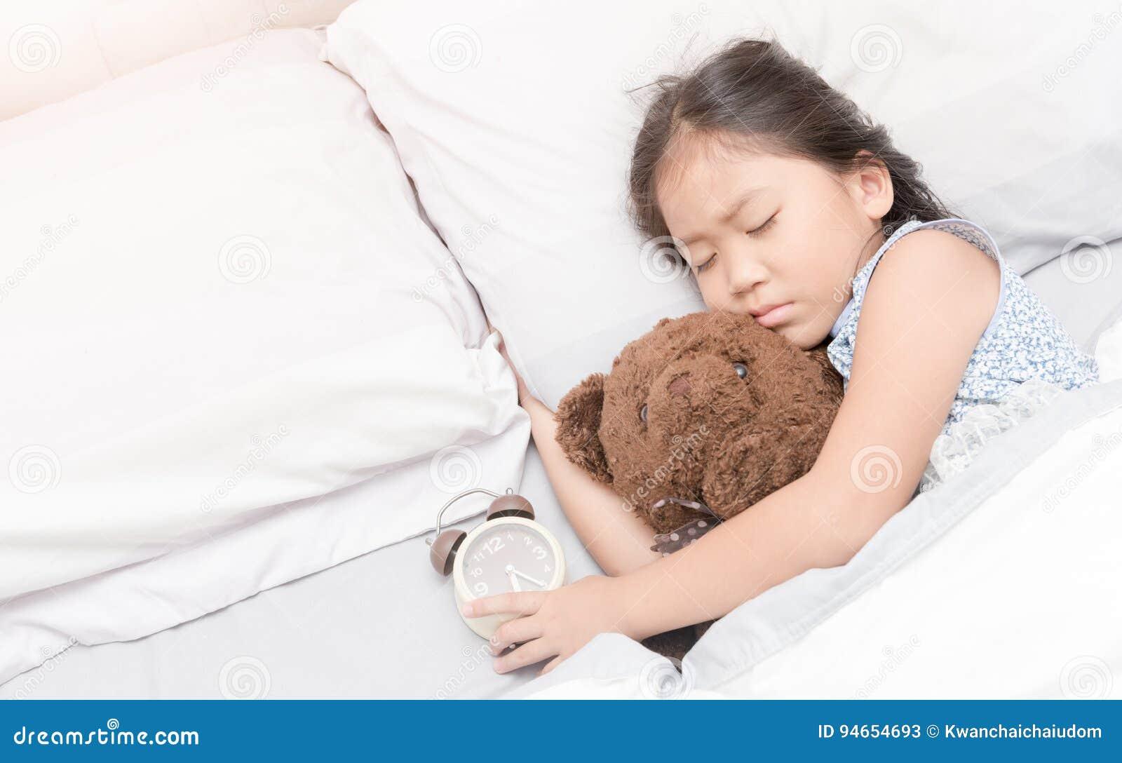 410578a95648 Cute Little Asian Girl Sleep And Hug Teddy Bear Stock Image - Image ...