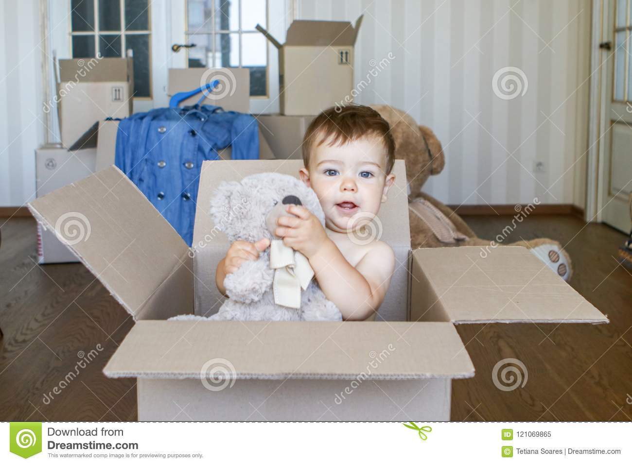 Baby Bedroom In A Box Special: Cute Little Baby Boy Inside Cardboard Box Holding And