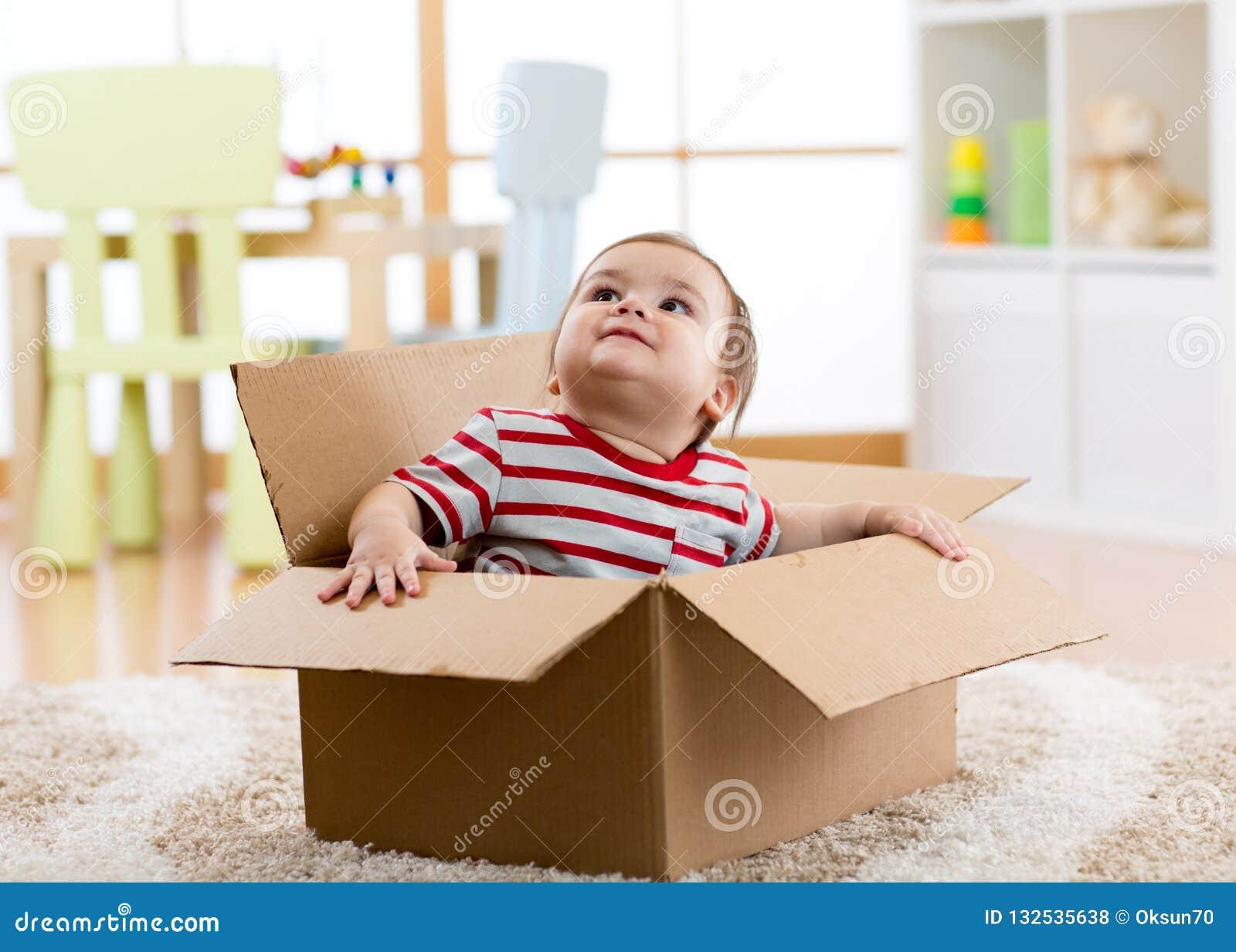 Cute Little Baby Boy Sitting Inside Cardboard Box, Moving ...