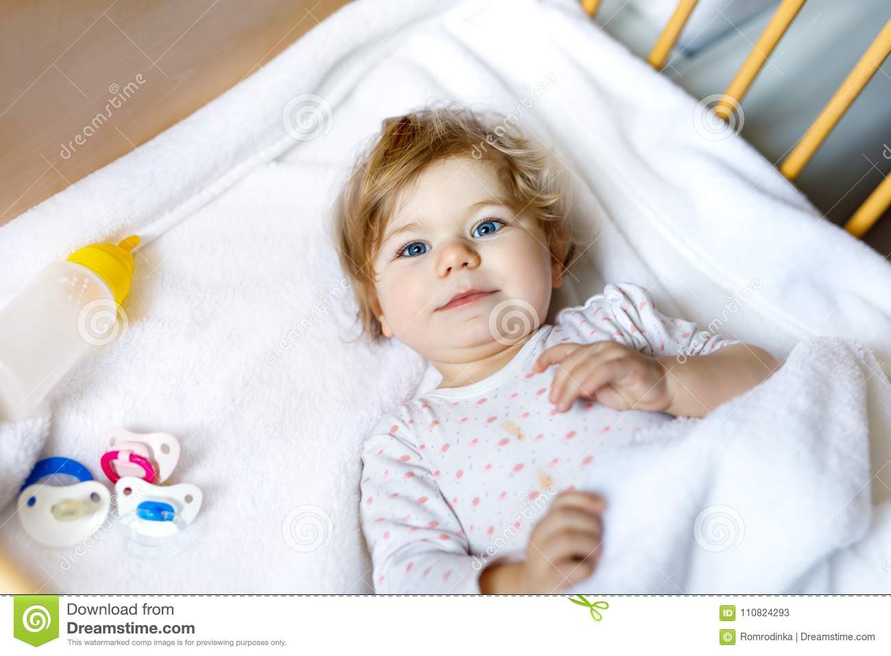 Cute Little Baby Girl Holding Bottle With Formula Mild And ...