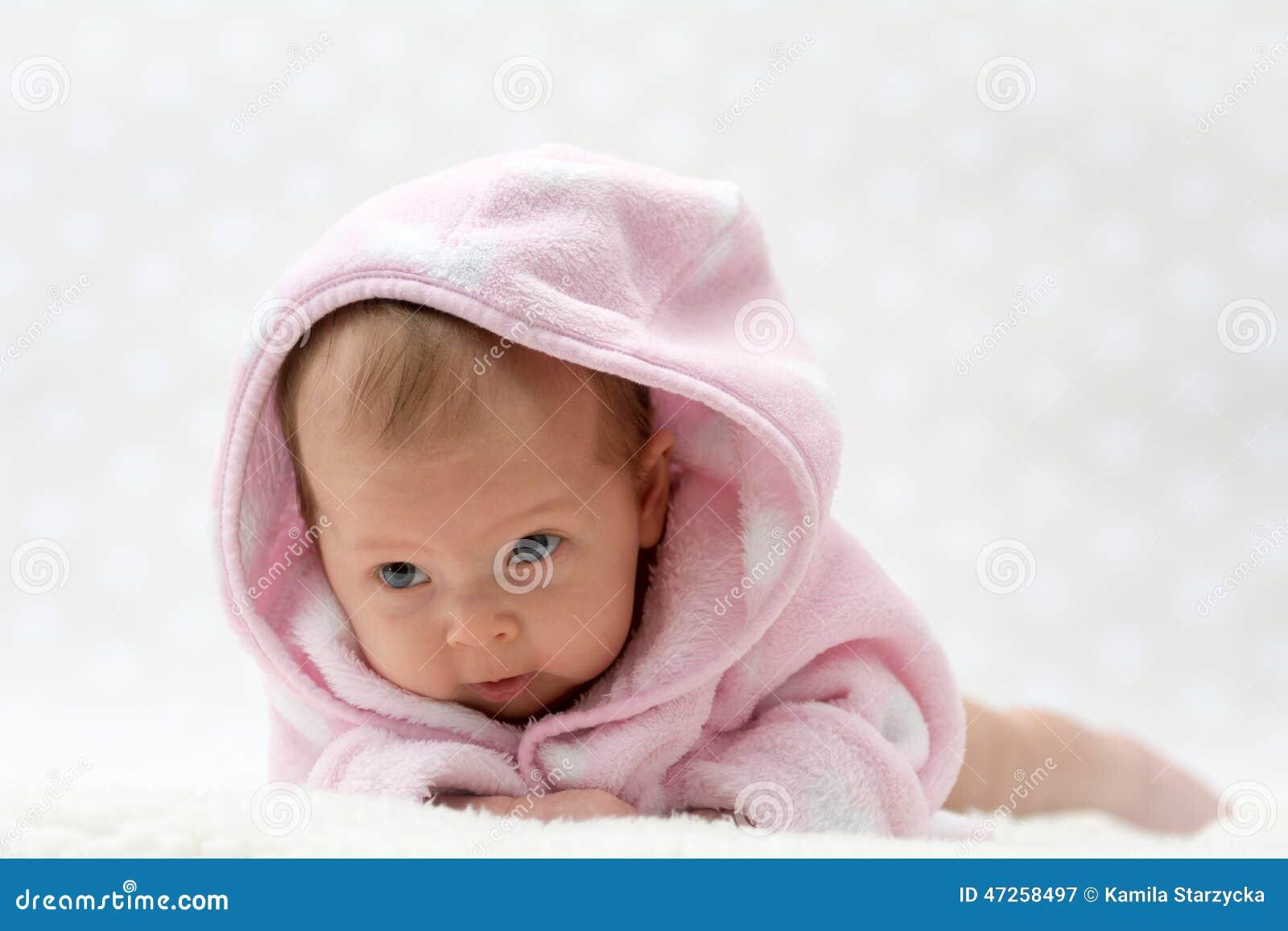 Cute Little Baby Girl Lying In Bath Stock Photo